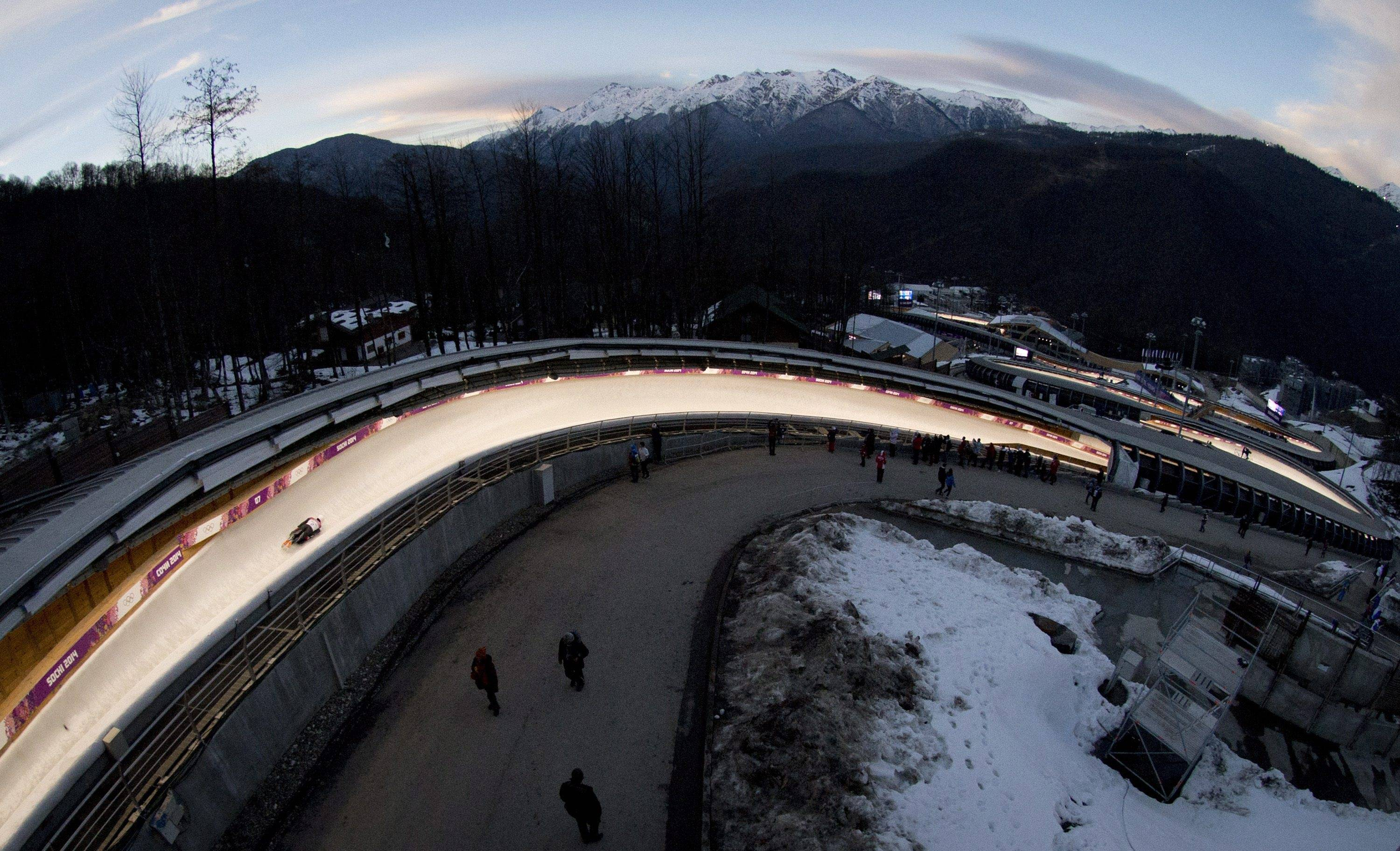 In this image taken with a fisheye lens, Matthew Antoine, of the United States, speeds down the track  during the second heat of the men's skeleton competition.