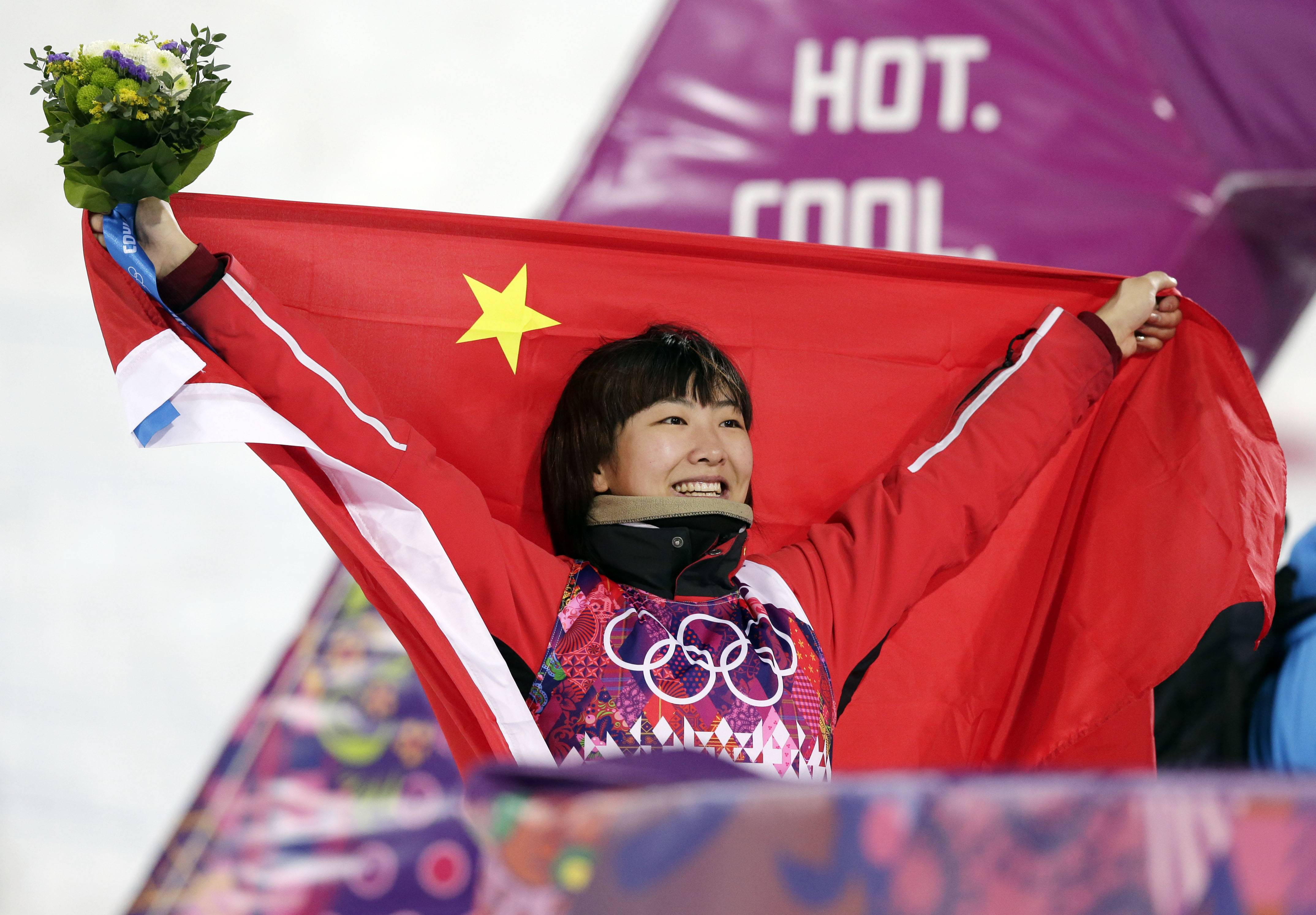 China's Xu Mengtao celebrates her silver medal in the women's freestyle skiing aerials final.