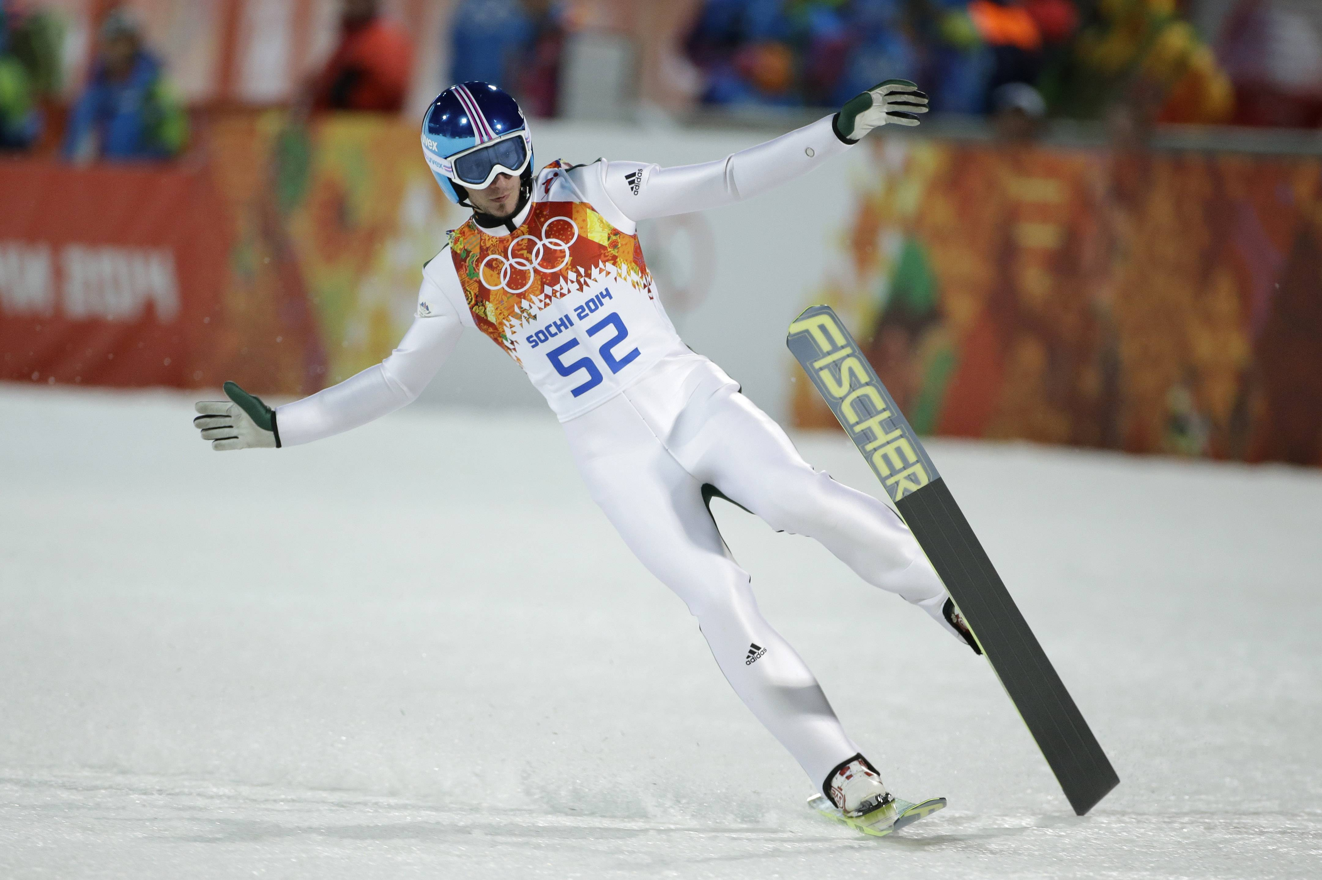 Slovenia's Robert Kranjec skis on one ski after an attempt during the ski jumping large hill qualification.