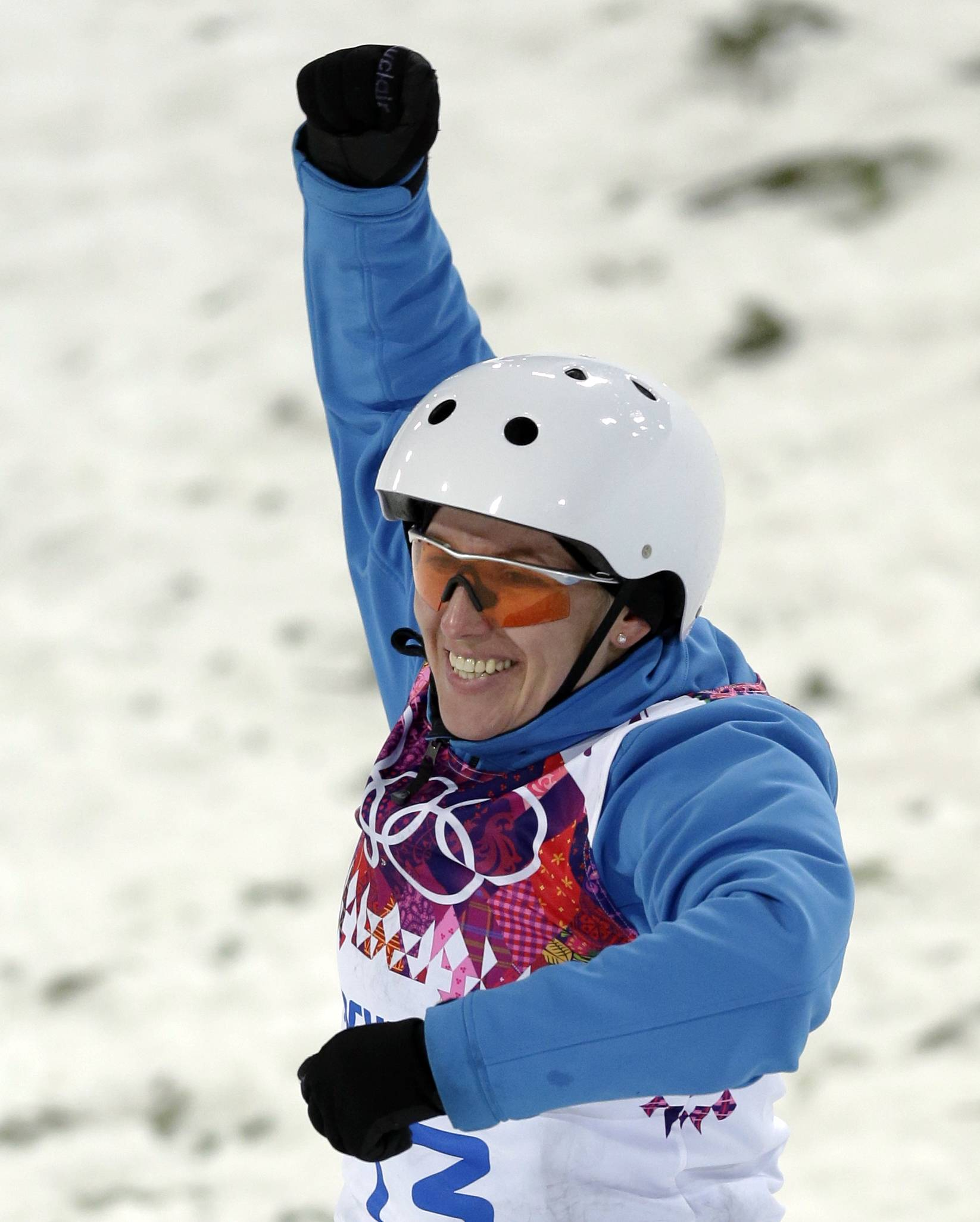 Alla Tsuper of Belarus celebrates after landing her final jump in  the women's freestyle skiing aerials final.