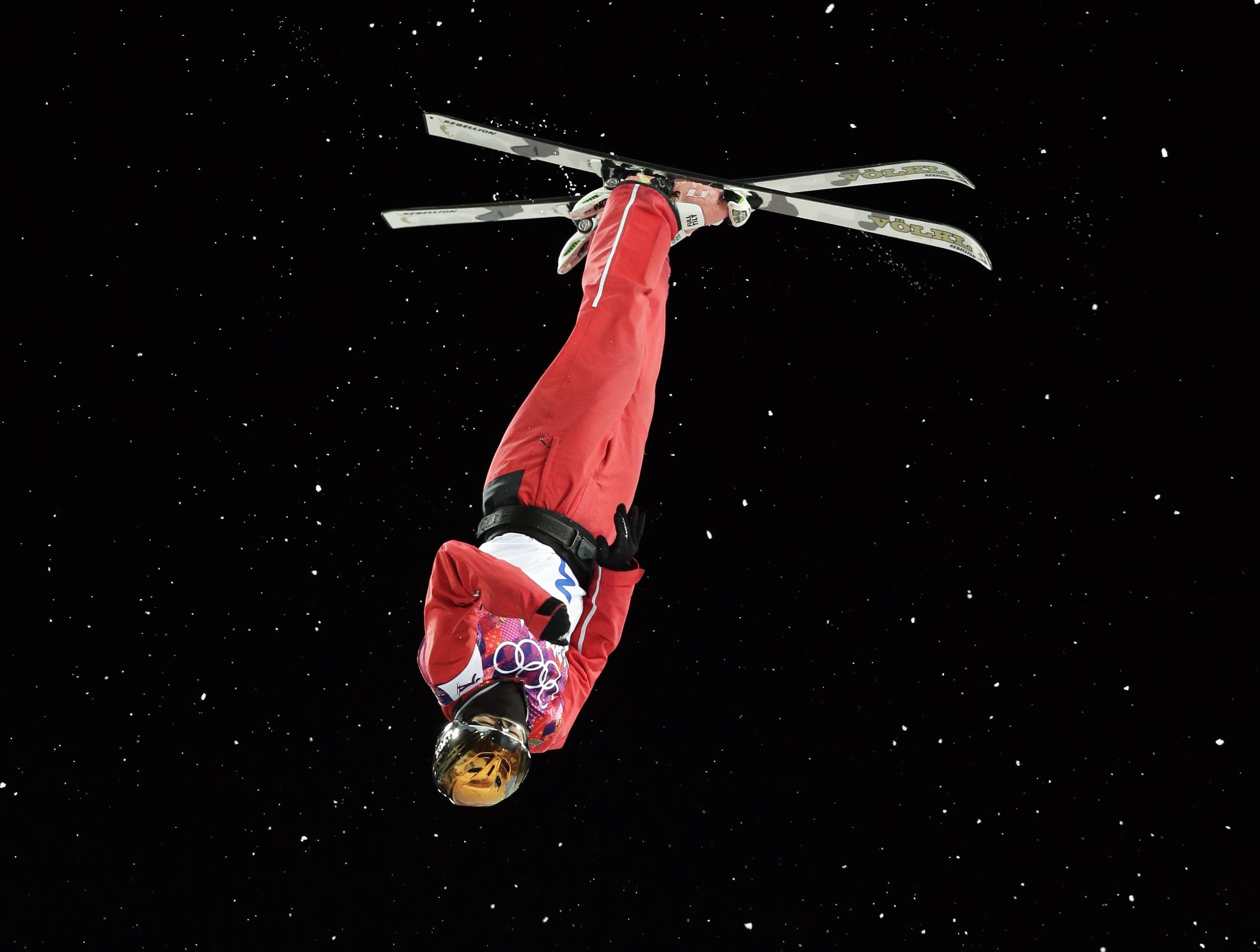 China's Xu Mengtao makes her silver medal winning jump during the women's freestyle skiing aerials final at the Rosa Khutor Extreme Park, at the 2014 Winter Olympics, Friday, Feb. 14, 2014, in Krasnaya Polyana, Russia.