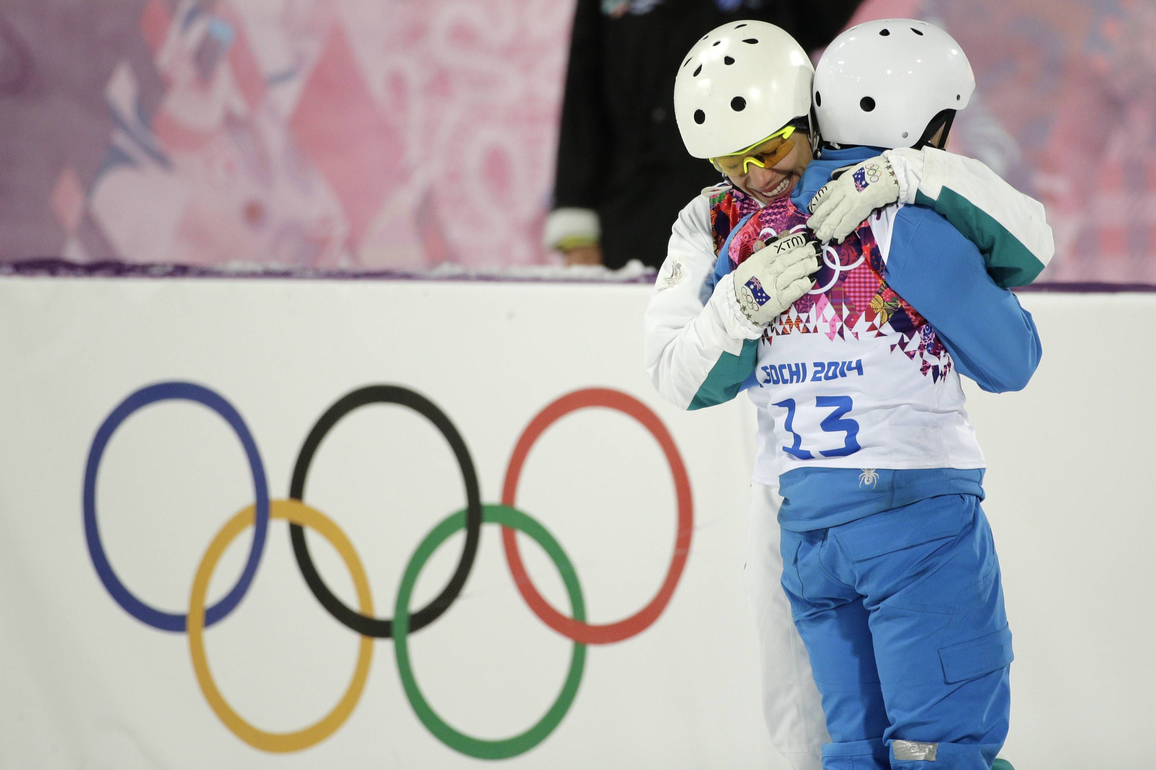 Women's freestyle skiing aerials gold medalist Alla Tsuper, of Belarus, is hugged by bronze medalist Lydia Lassila, of Australia.