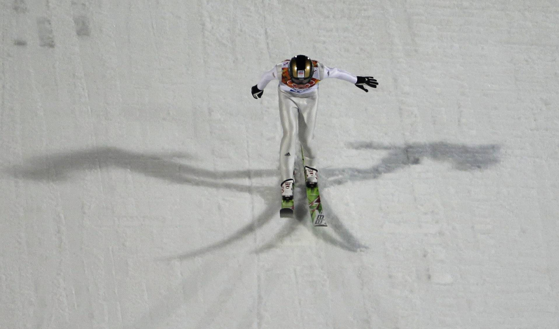 Czech Republic's Antonin  Hajek lands his attempt during the ski jumping large hill qualification.