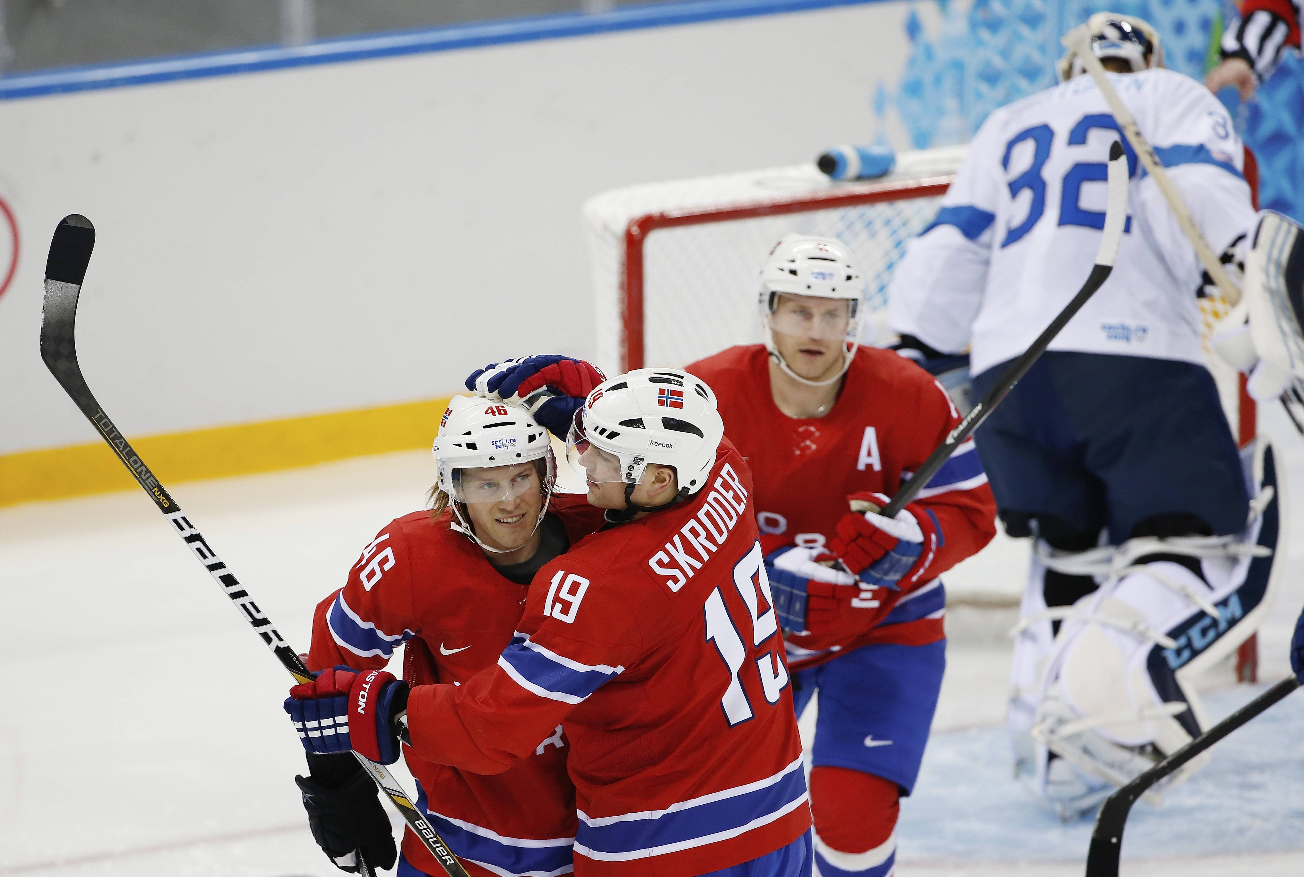 Norway forward Per-Age Skroder celebrates his goal against Finland with teammate Mathis Olimb as Finland goalkeeper Kari Lehtonen skates away.