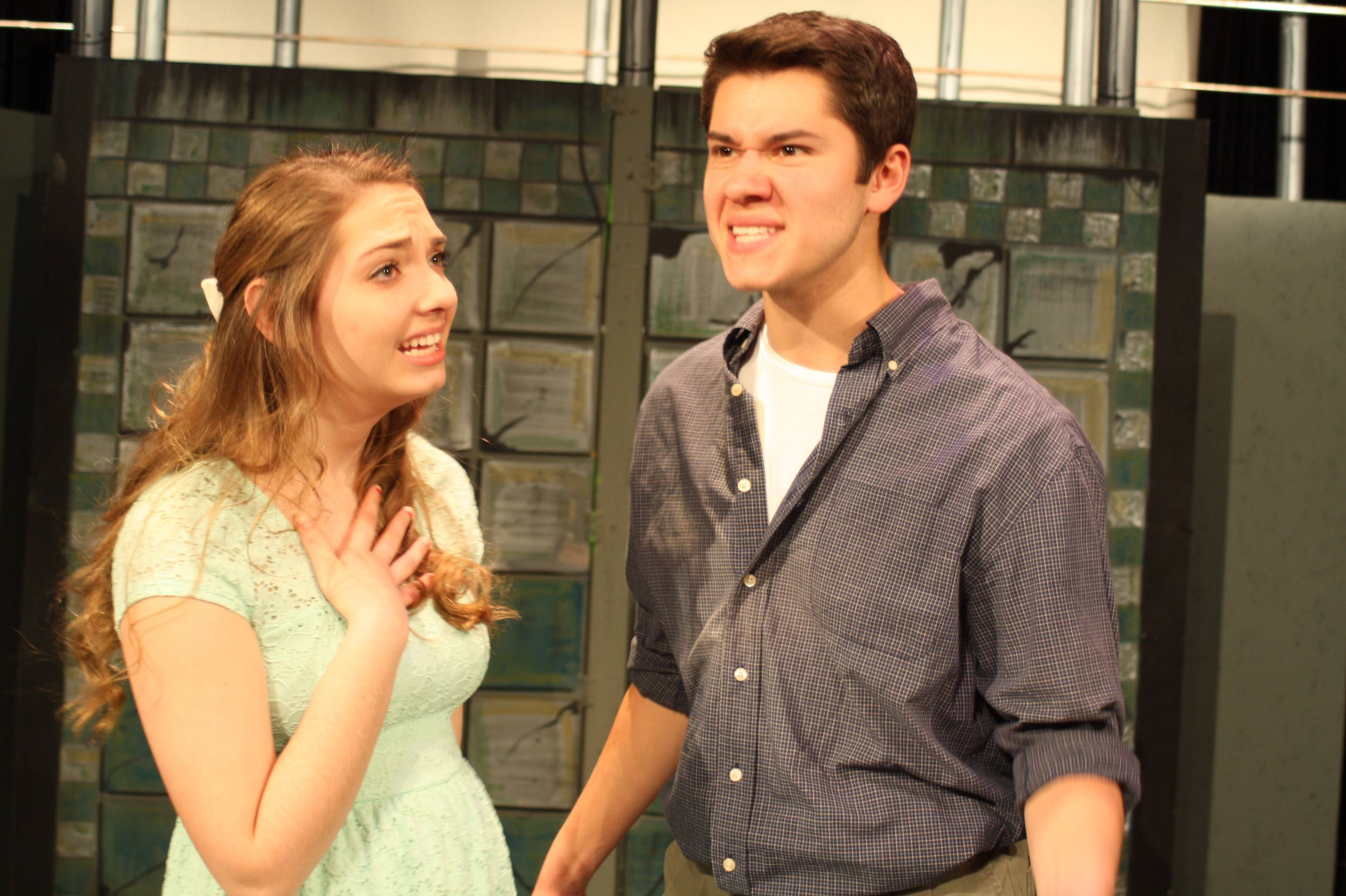 Emily Miller as Hope Cladwell pleads with Bobby Wozniak as Bobby Strong to stop the revolution in Urinetown.