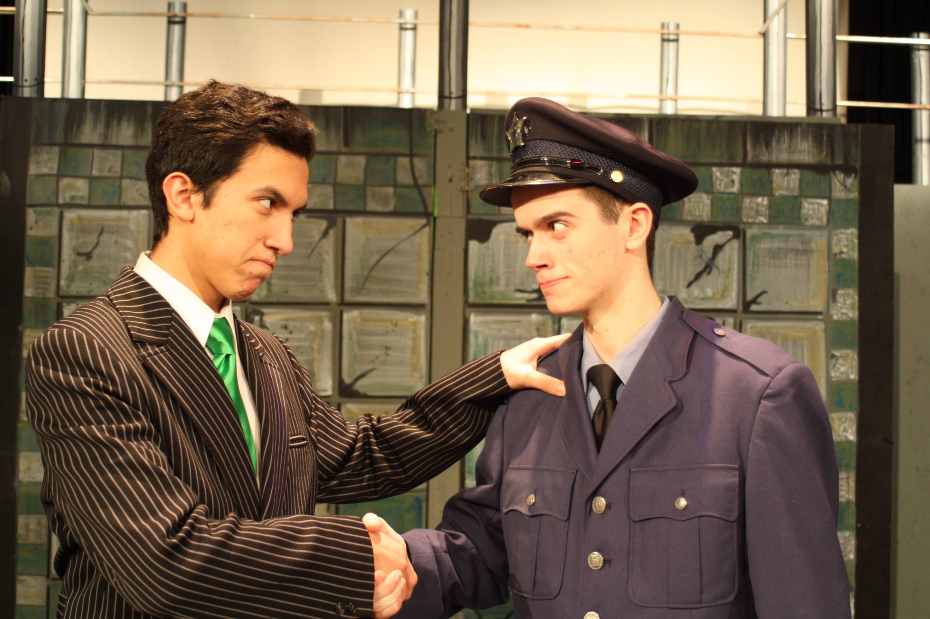 Andre Serbia as Caldwell B. Cladwell and Matt Emery as Officer Lockstock hatch a plan to stop the revolt.