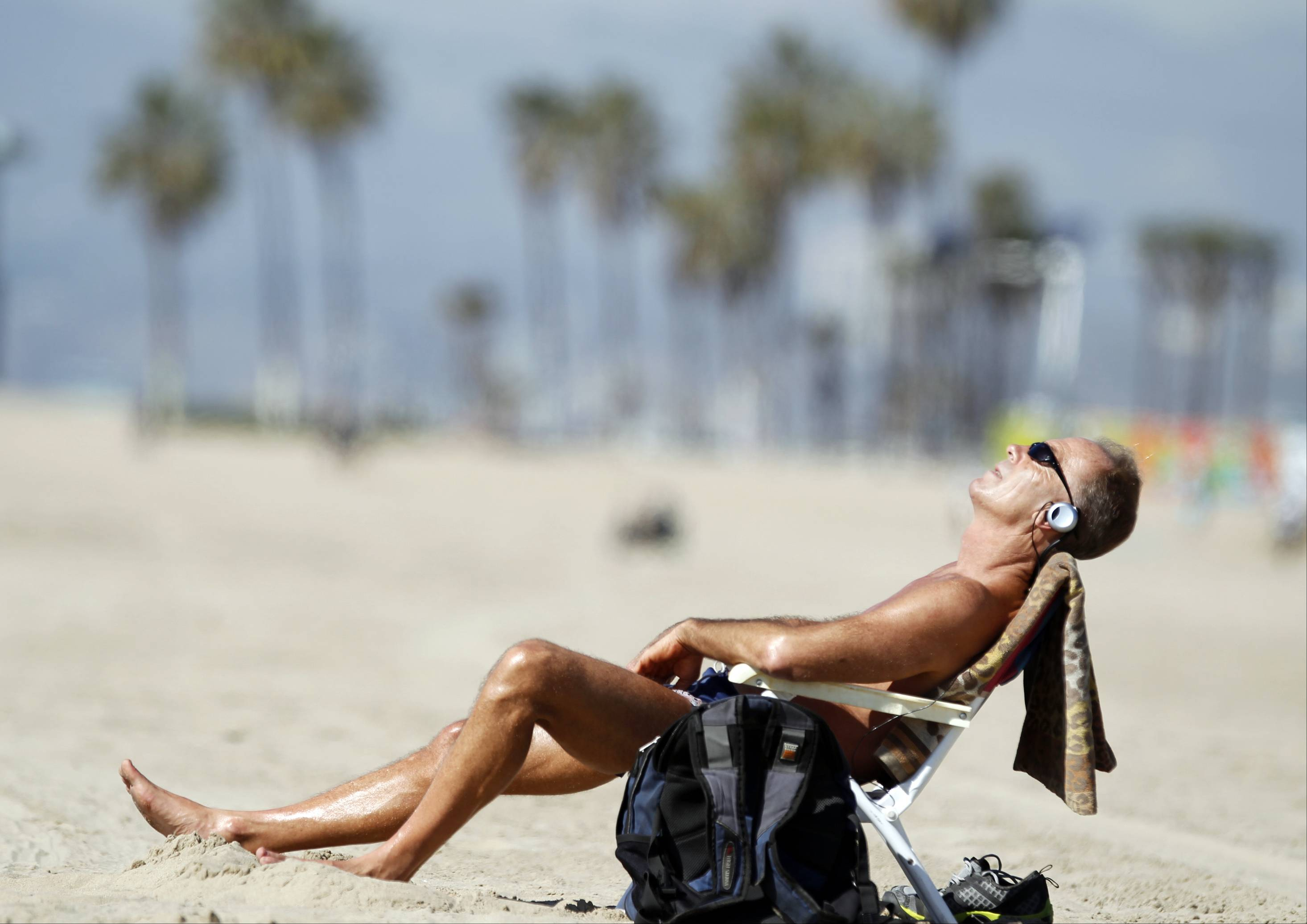 Venice Beach resident David Lomax enjoys the warm weather Friday in the Venice Beach area of Los Angeles. While a drought has stricken central California, southern grape growers report a record harvest for 2013.