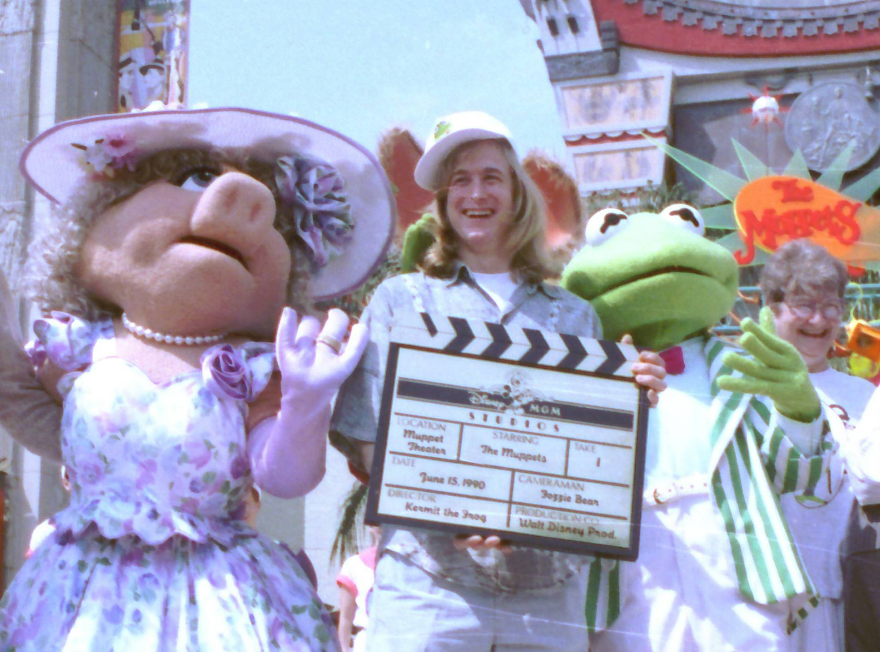 "Puppeteer John Henson, the son of the late Muppets creator Jim Henson, is seen with Muppets Miss Piggy and Kermit at the Disney/MGM studios in Lake Buena Vista, Florida. Cheryl Henson says her brother died of a ""massive heart attack"" died at his home in Saugerties, New York on Friday Feb. 14, 2014. He was 48."