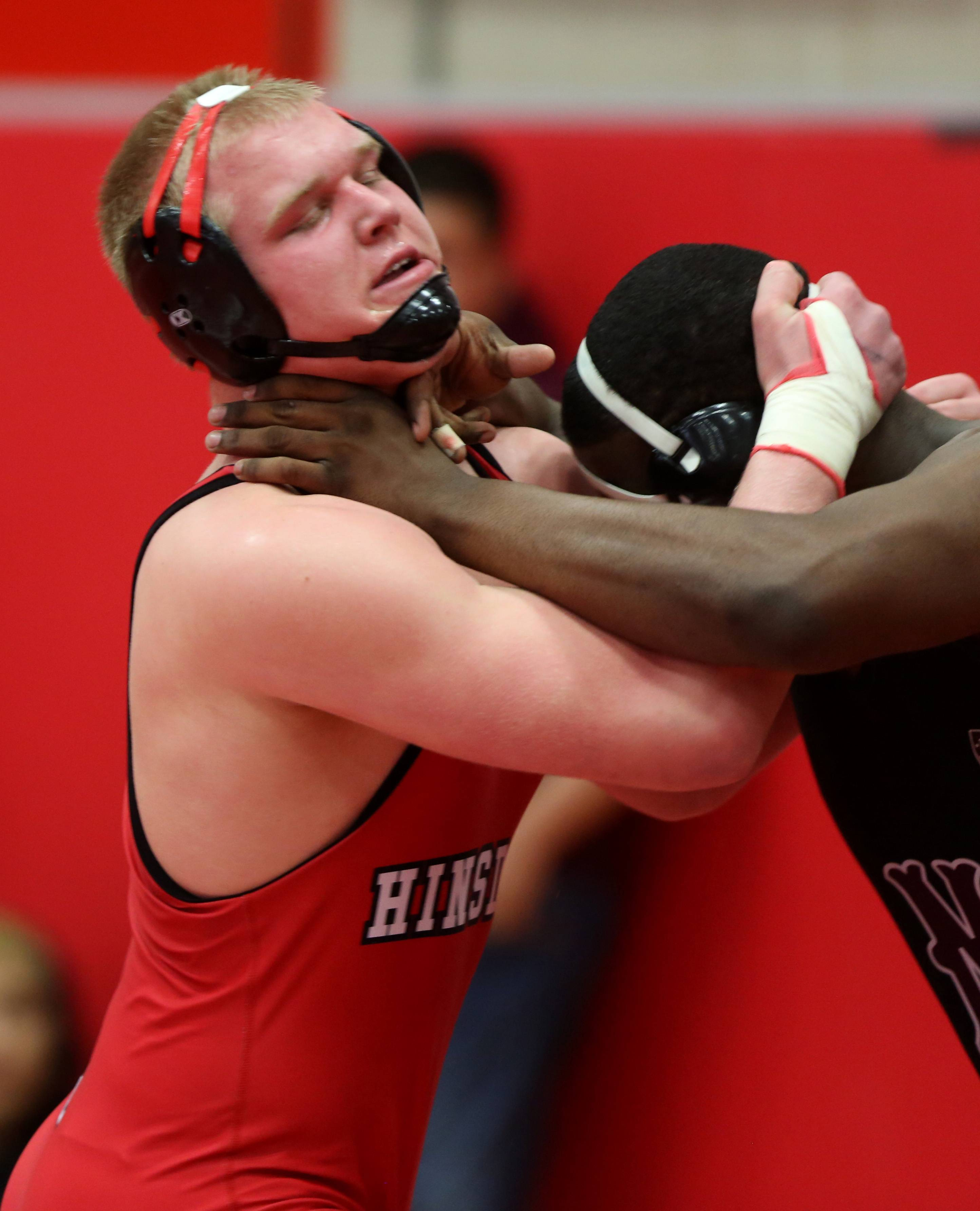 Hinsdale Central's Matt Allen defeats Morton's Kevion Anderson 6-4, in the 220 pound class of the 3A Hinsdale Central individual wrestling sectional semifinals.