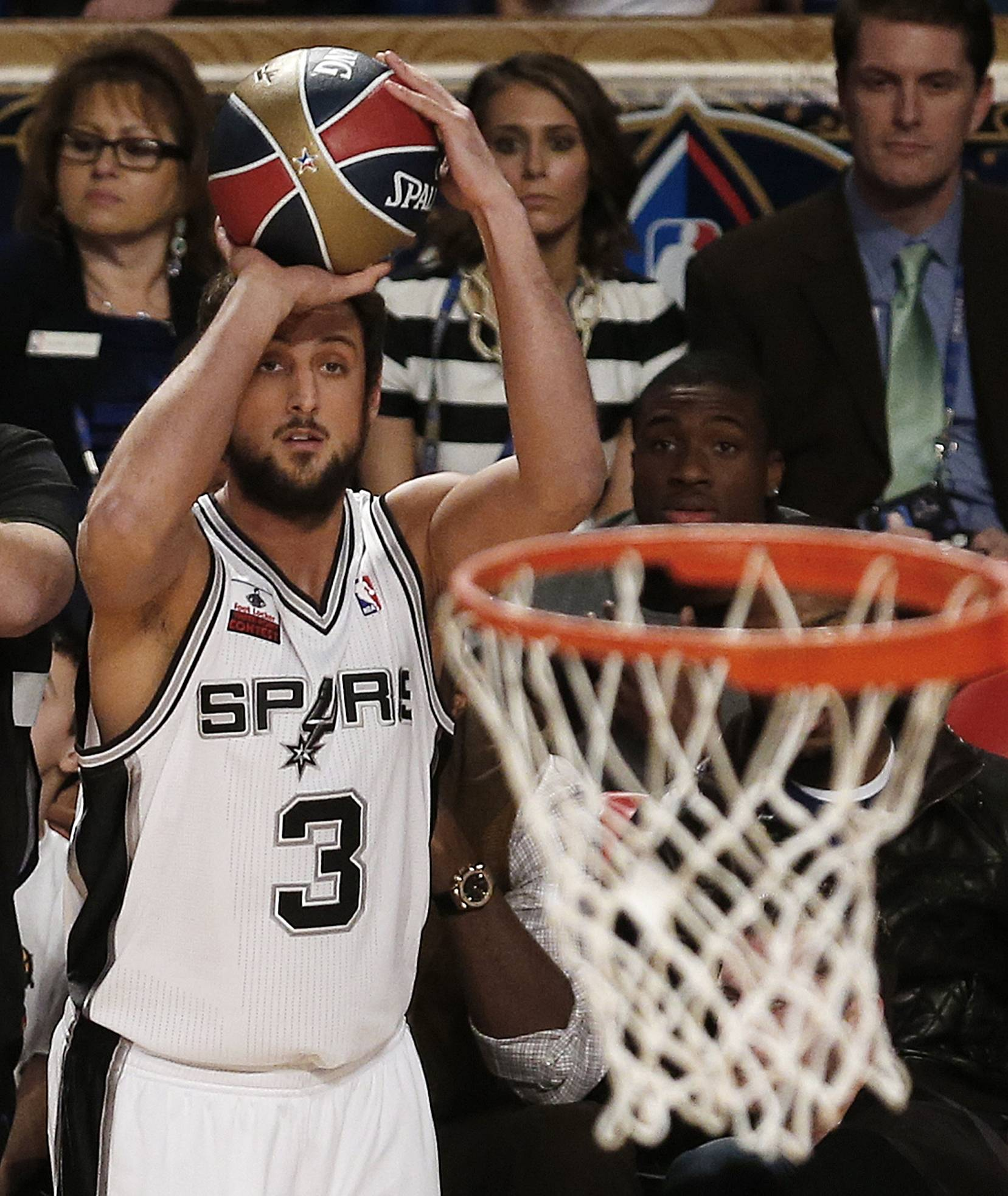 Marco Belinelli of the San Antonio Spurs shoots for the three-point contest during the skills competition at the NBA All-Star basketball game Saturday in New Orleans.