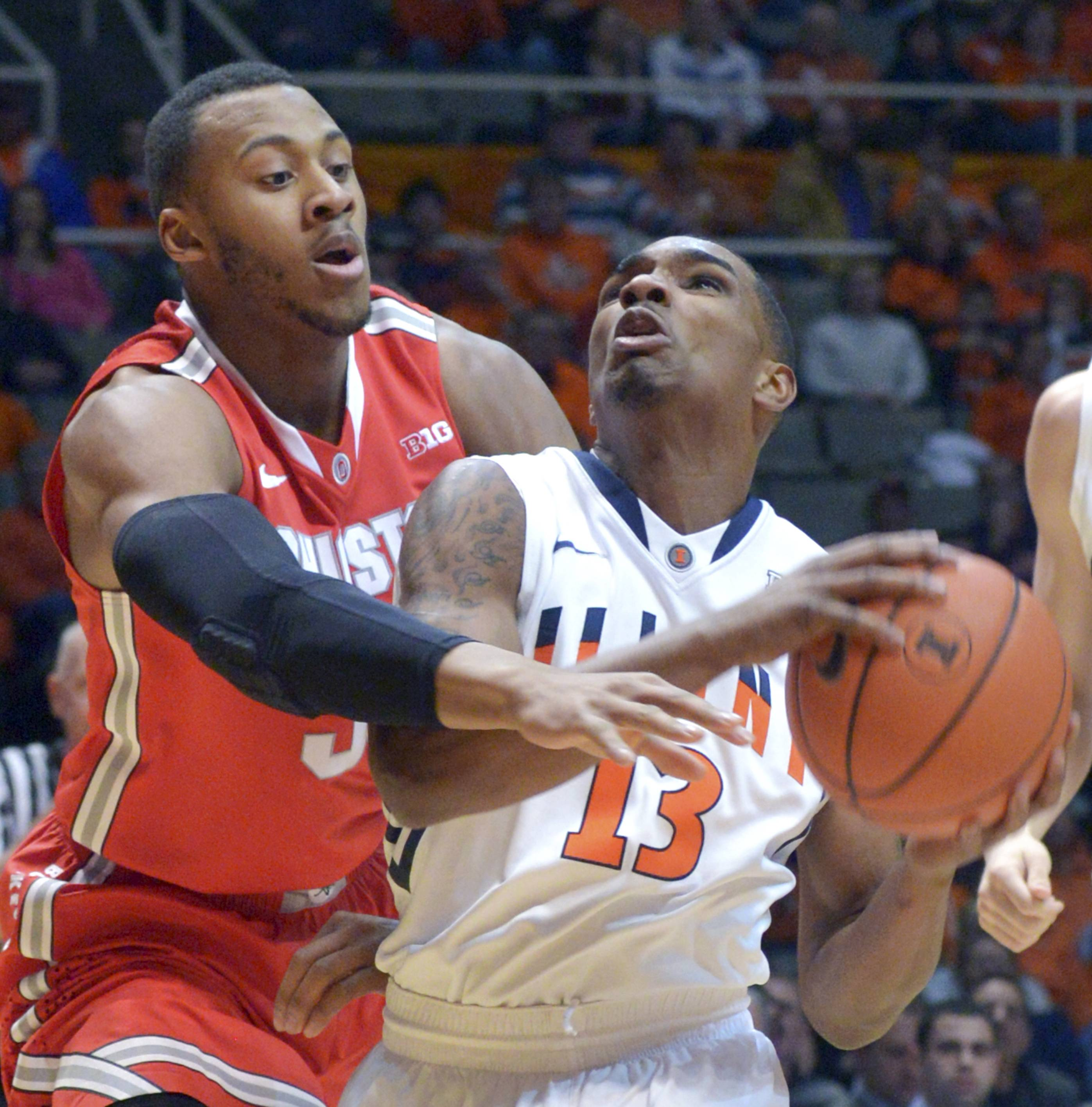 Ohio State's center Trey McDonald (55) defends Illinois' Tracy Abrams (13) during Saturday night's game in Champaign. The Illini lost, 48-39.