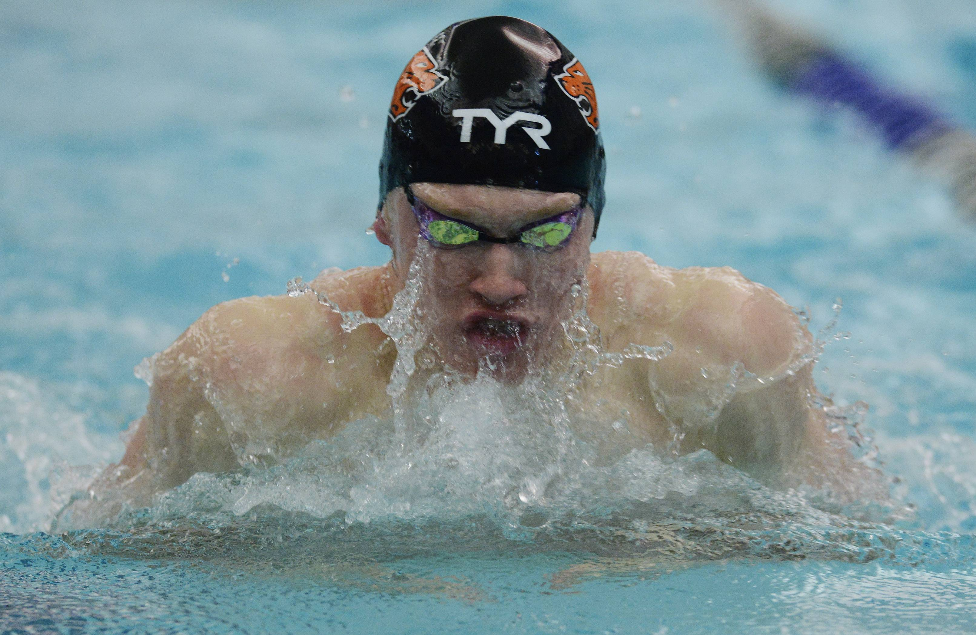 Libertyville's Bobby Snader swims breaststroke in the 200-yard medley relay during the North Suburban Conference boys swimming meet at Vernon Hills on Saturday.