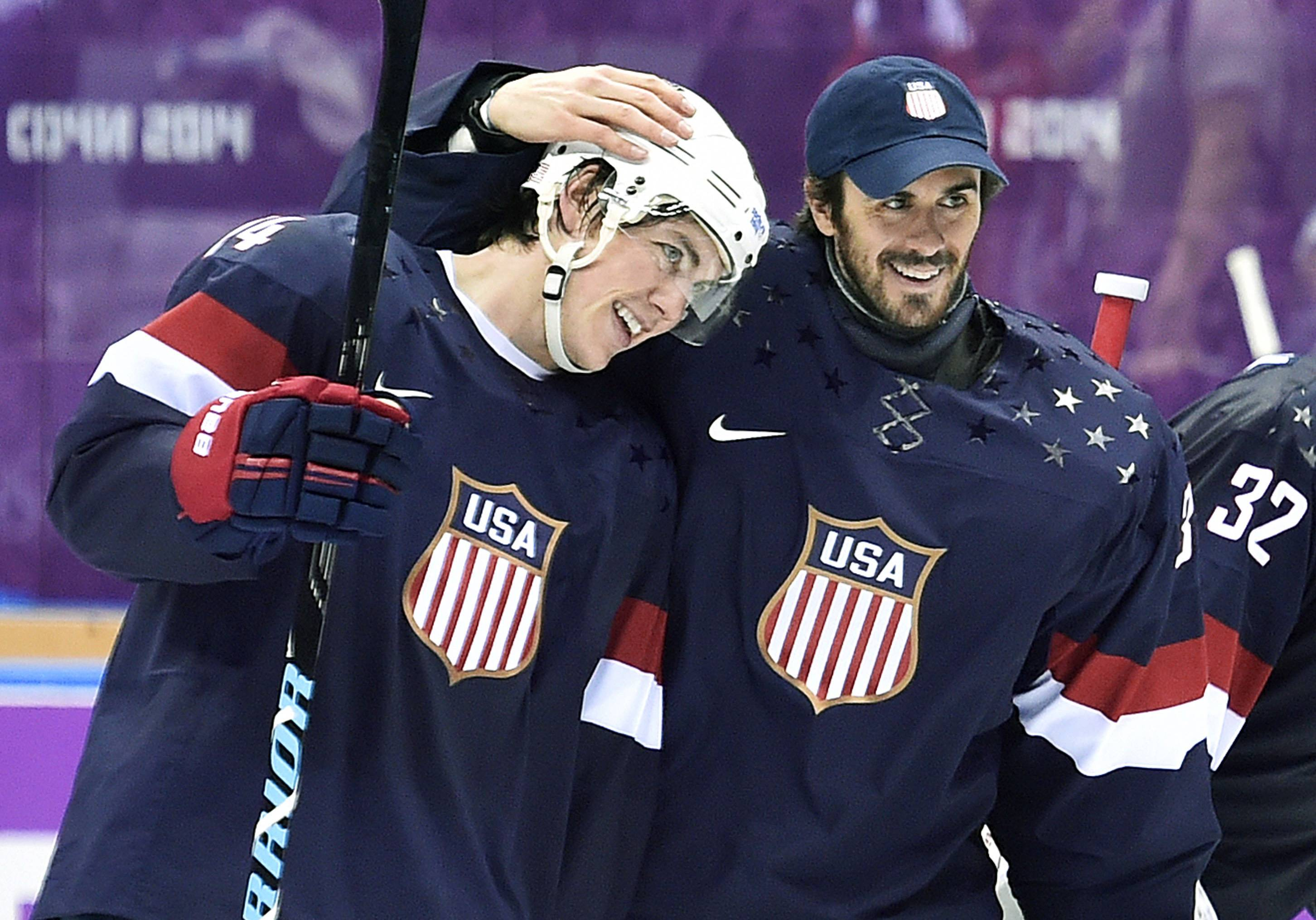 United States forward T.J. Oshie, left, is congratulated by goalie Ryan Miller, right, after Oshie scored the game-winning goal in a shootout against Russia in a men's ice hockey game at the 2014 Winter Olympics, Saturday, Feb. 15, in Sochi, Russia. The U.S. won 3-2 in a shootout.