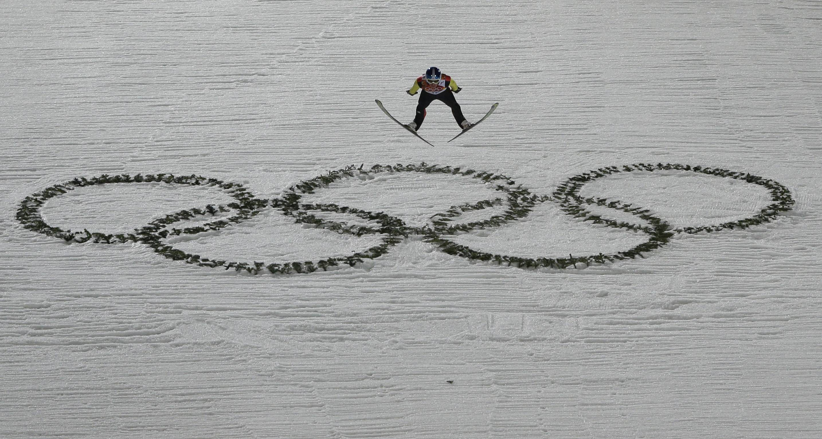 Germany's Severin Freund makes an attempt during the ski jumping large hill final at the 2014 Winter Olympics, Saturday, Feb. 15, 2014, in Krasnaya Polyana, Russia.