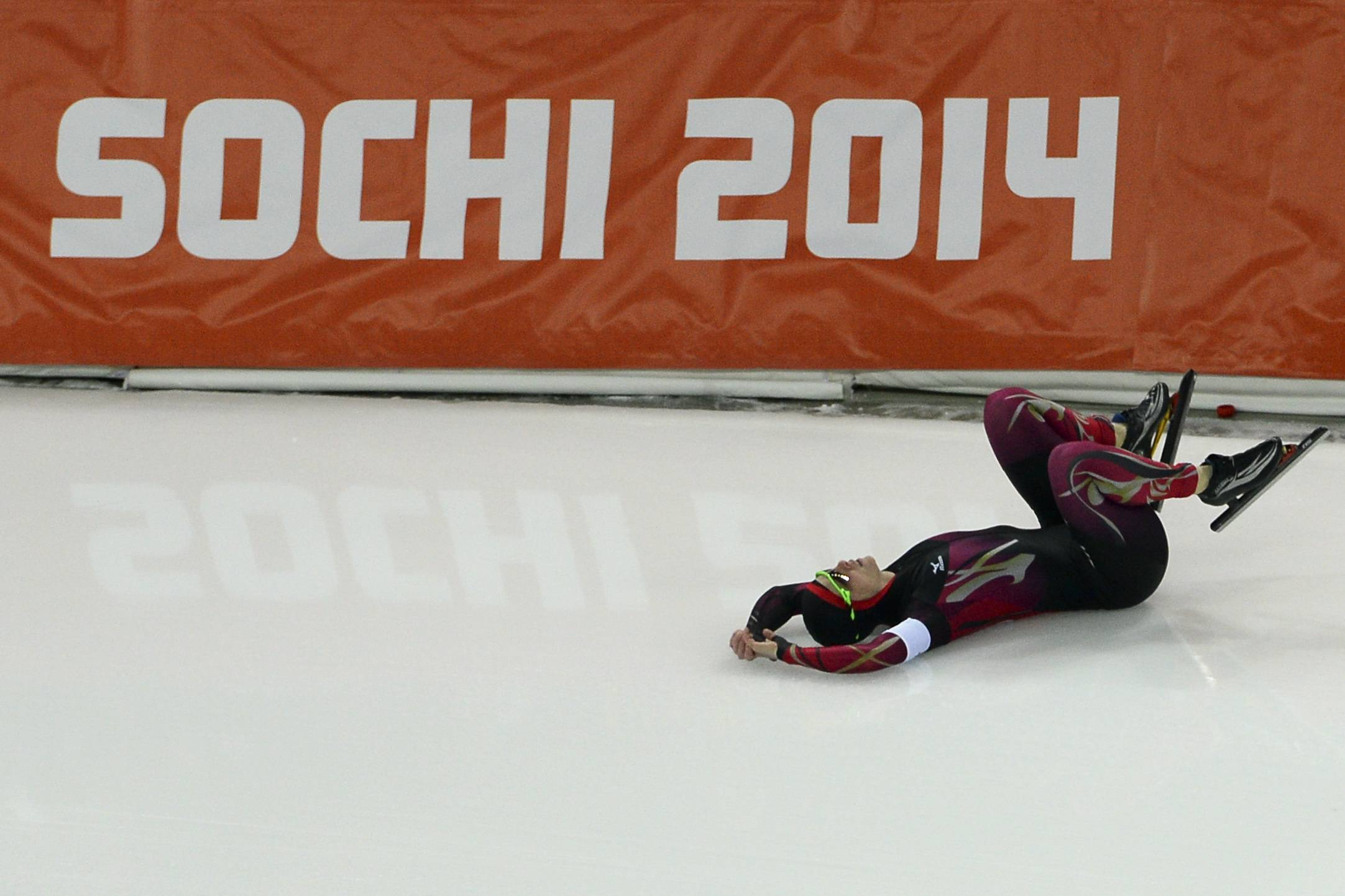 Monique Angermueller of Germany crashes during the women's 1,000-meter speedskating race at the Adler Arena Skating Center during the 2014 Winter Olympics in Sochi, Russia, Thursday, Feb. 13, 2014.