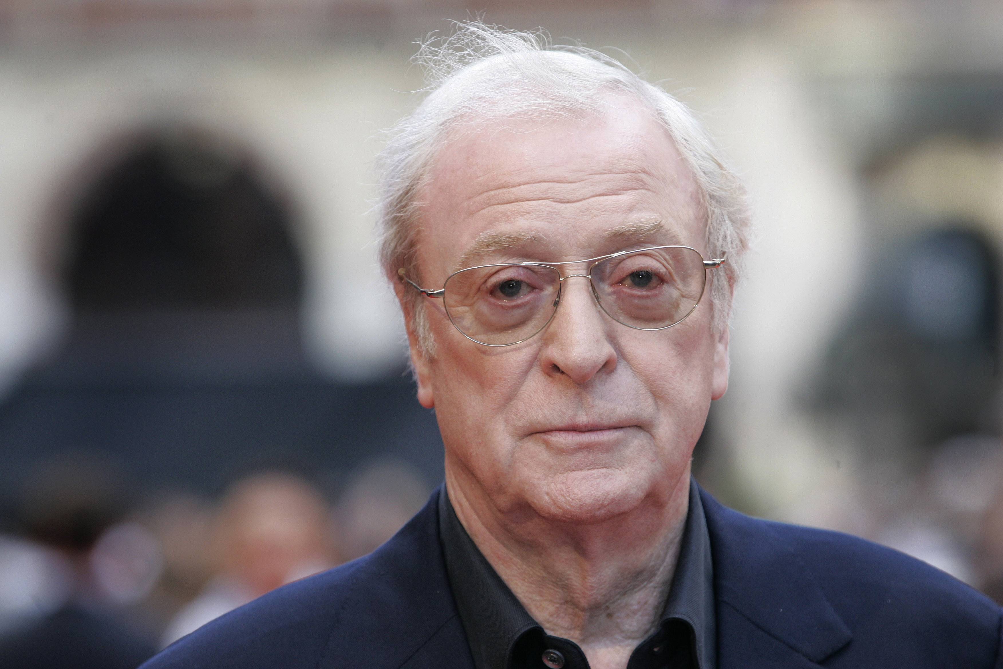 "British actor Michael Caine arrives for the European Premiere of 'The Dark Knight,' in central London. For the past three decades, many Britons had hoped the rigid class system that defined their country from Dickens to ""Downton Abbey"" was finally dying. Now they fear that class, their old bugbear, is back on the rise."