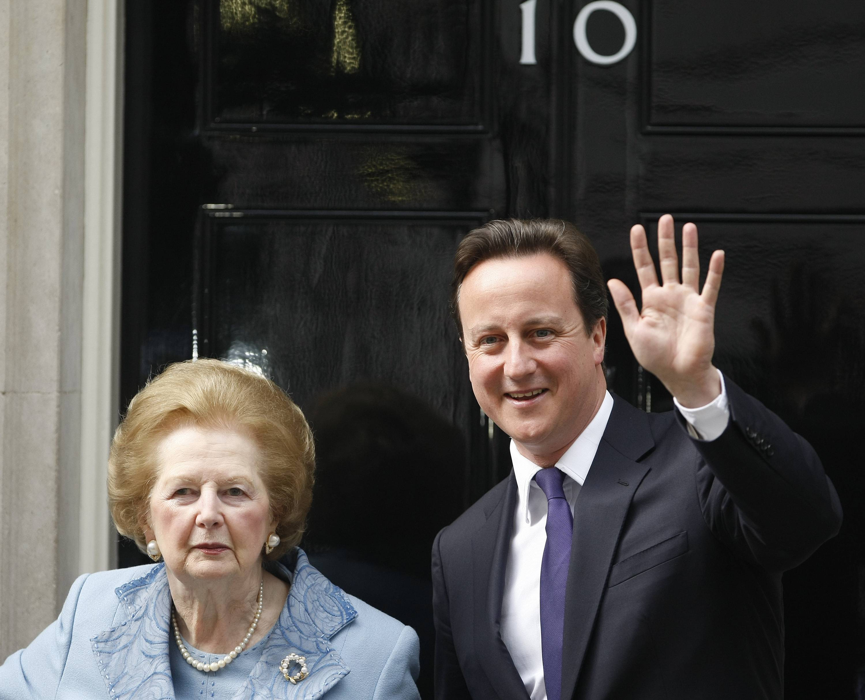 Britain's Prime Minister David Cameron, right, poses with former Prime Minister Margaret Thatcher on the doorstep of 10 Downing Street in London.
