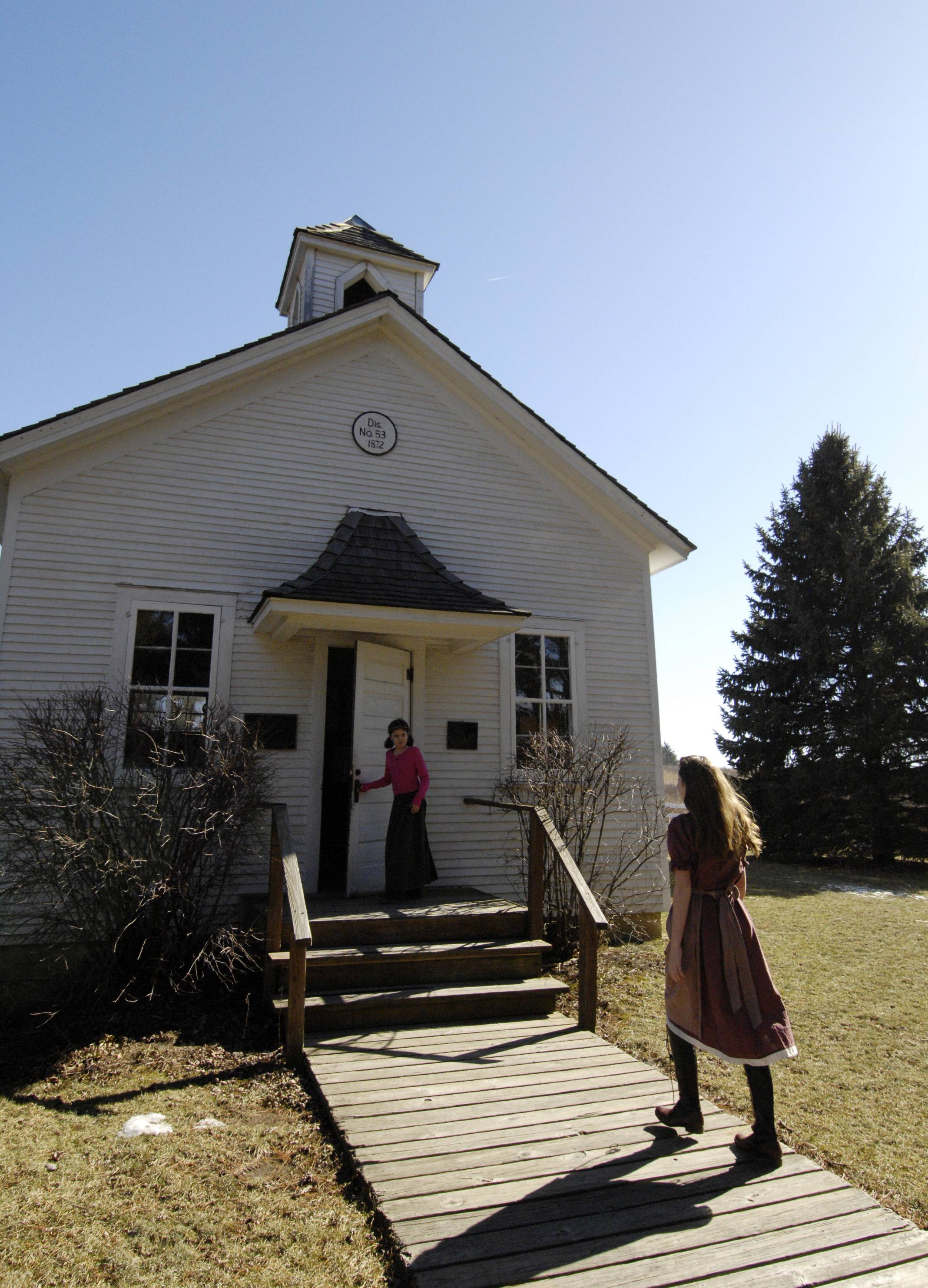 Piper Winkler, 13 of Geneva walks up the board walkway to the historic Pioneer Sholes one-room schoolhouse in the LeRoy Oakes Forest Preserve, Sunday during their winter open house.