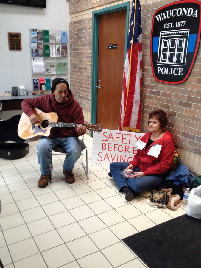 Protesters staged a sit-in at the Wauconda police department to challenge a proposal to shut down the village's 911 center and outsource dispatching to Lake Zurich.