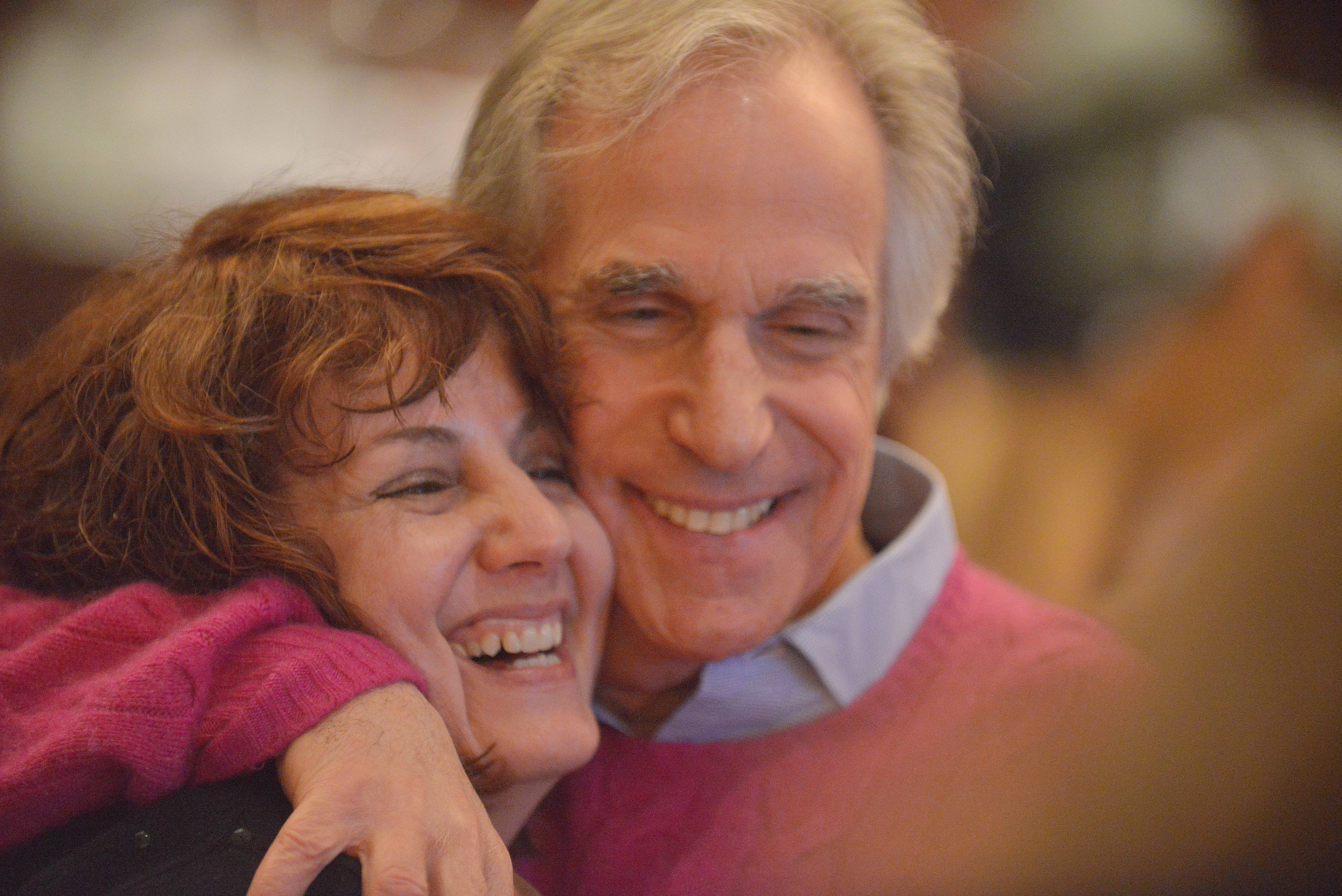 "Henry Winkler, who portrayed the Fonz on the TV show ""Happy Days,"" greets fan Kim Crawshaw of Geneva on Saturday during the annual Children's Literature Breakfast sponsored by Anderson's Bookshop of Naperville. Winkler and his writing partner Lin Oliver were among featured authors at the breakfast and spoke about the first two installments in their new children's book series ""Here's Hank."""