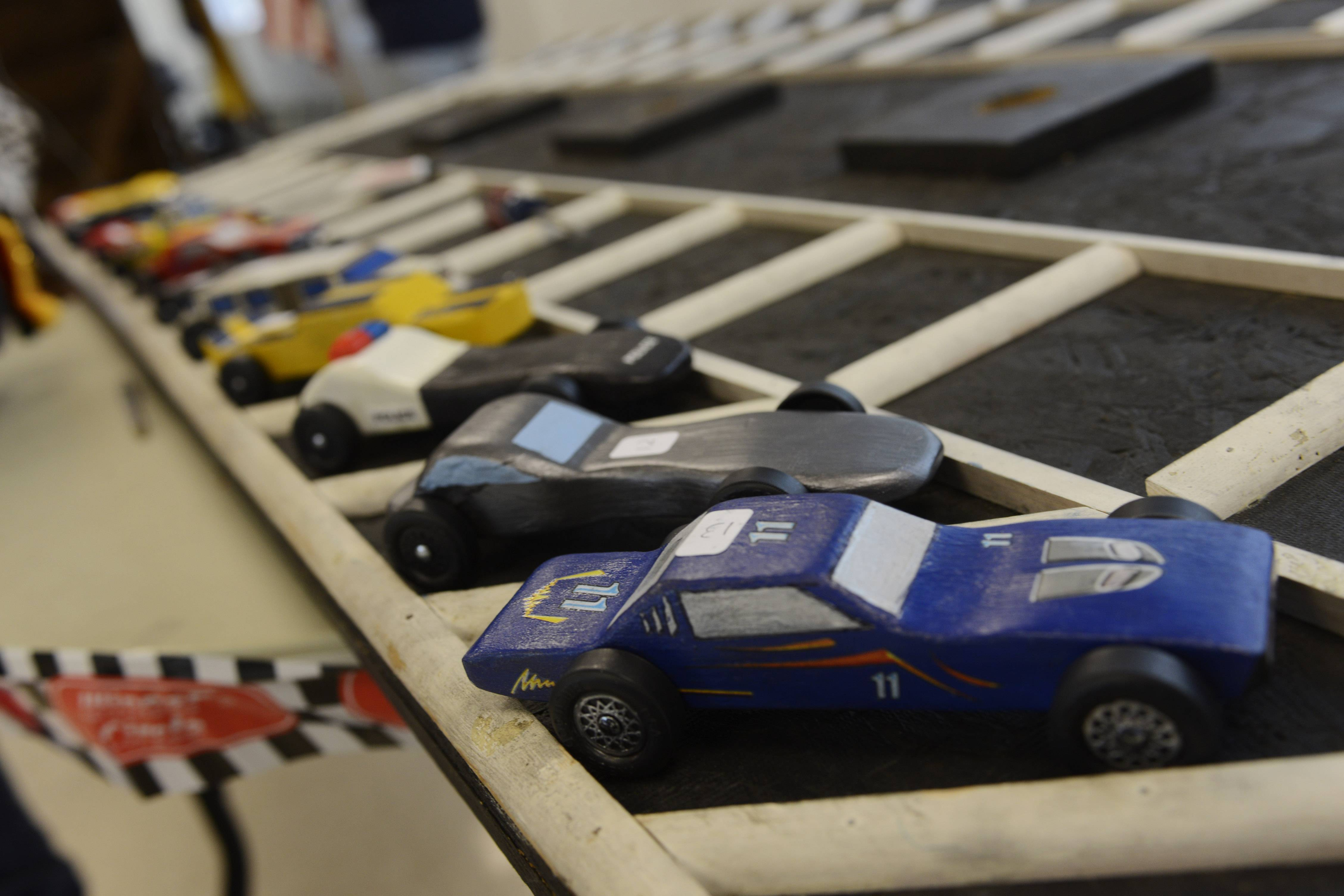 Cars are displayed in the pit area Saturday during the Cub Scout Super Pack 199 annual Pinewood Derby at the Round Lake Area Park District's Robert W. Rolek Community Center.