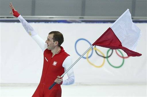 Gold medallist Poland's Zbigniew Brodka holds his national flag and celebrates after the men's 1,500-meter speedskating race at the Adler Arena Skating Center during the 2014 Winter Olympics in in Sochi, Russia, Saturday, Feb. 15, 2014.