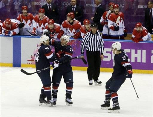 USA forward T.J. Oshie is congratulated by USA forward Ryan Callahan and forward Paul Stastny after Oshie scored the winning goal in a shootout against Russia during overtime of a men's ice hockey game at the 2014 Winter Olympics, Saturday, Feb. 15, 2014, in Sochi, Russia.