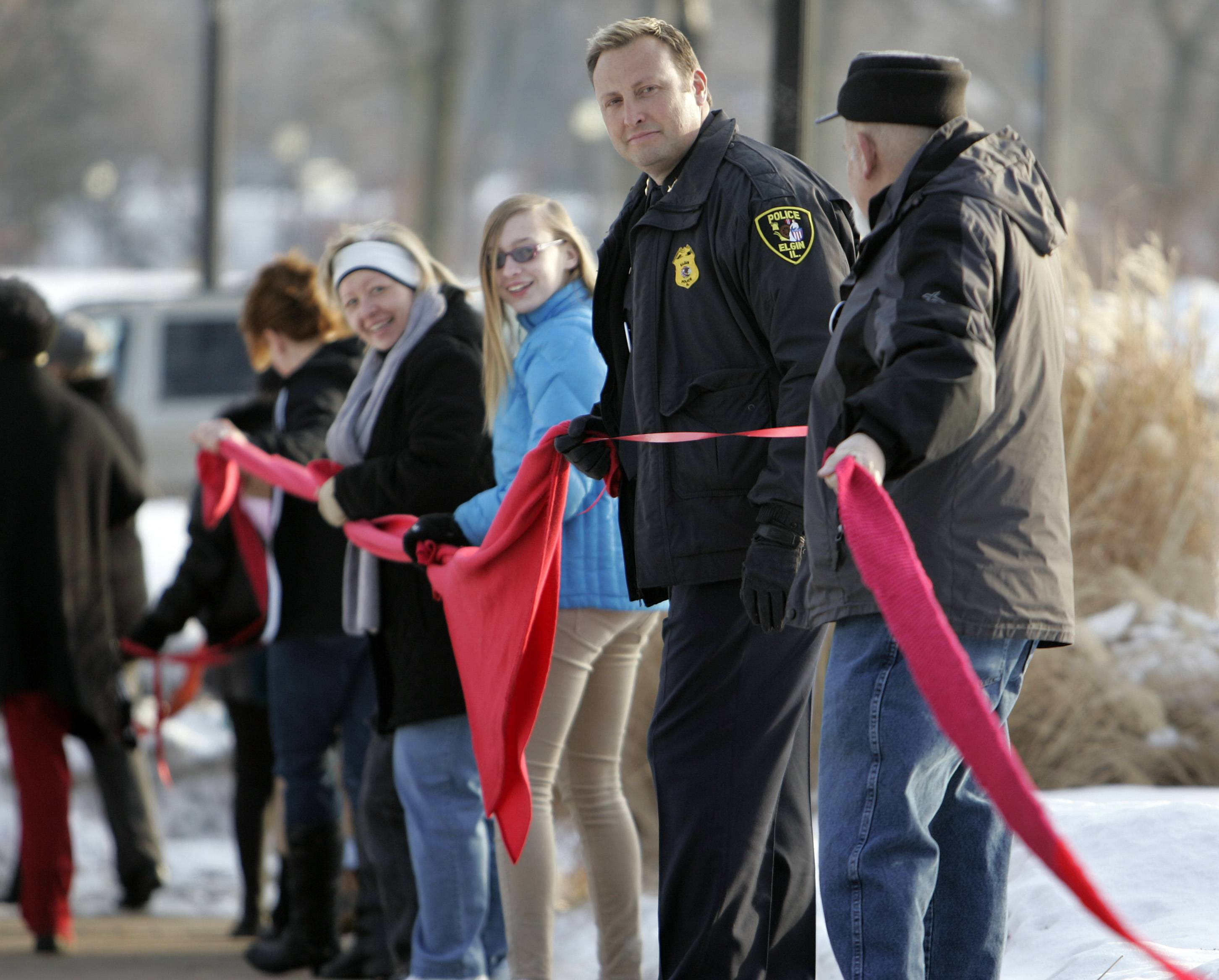 "Elgin Police Chief Jeff Swoboda and other members of the police department joined about 110 people Friday at the Gail Borden Public Library in Elgin during the ""One Billion Rising"" global campaign to call for justice and to end violence against women and girls."