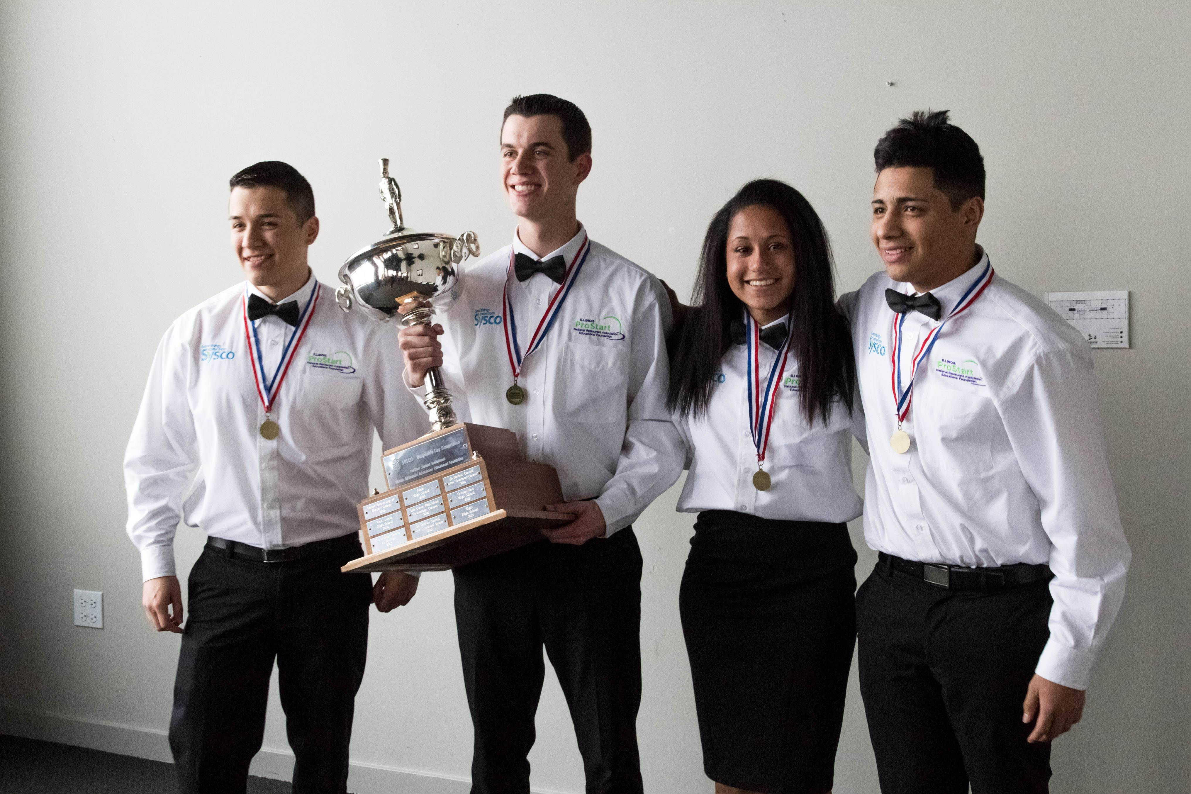 The Elgin High Clumsy Chefs restaurant management team put together a winning restaurant concept that earned first place Feb. 8 in the Illinois ProStart Competition in Chicago. Students, from left, Eduardo Rios, Colin Flanagan, Yahaira Bonilla and Luis Maldonado show their first-place trophy.
