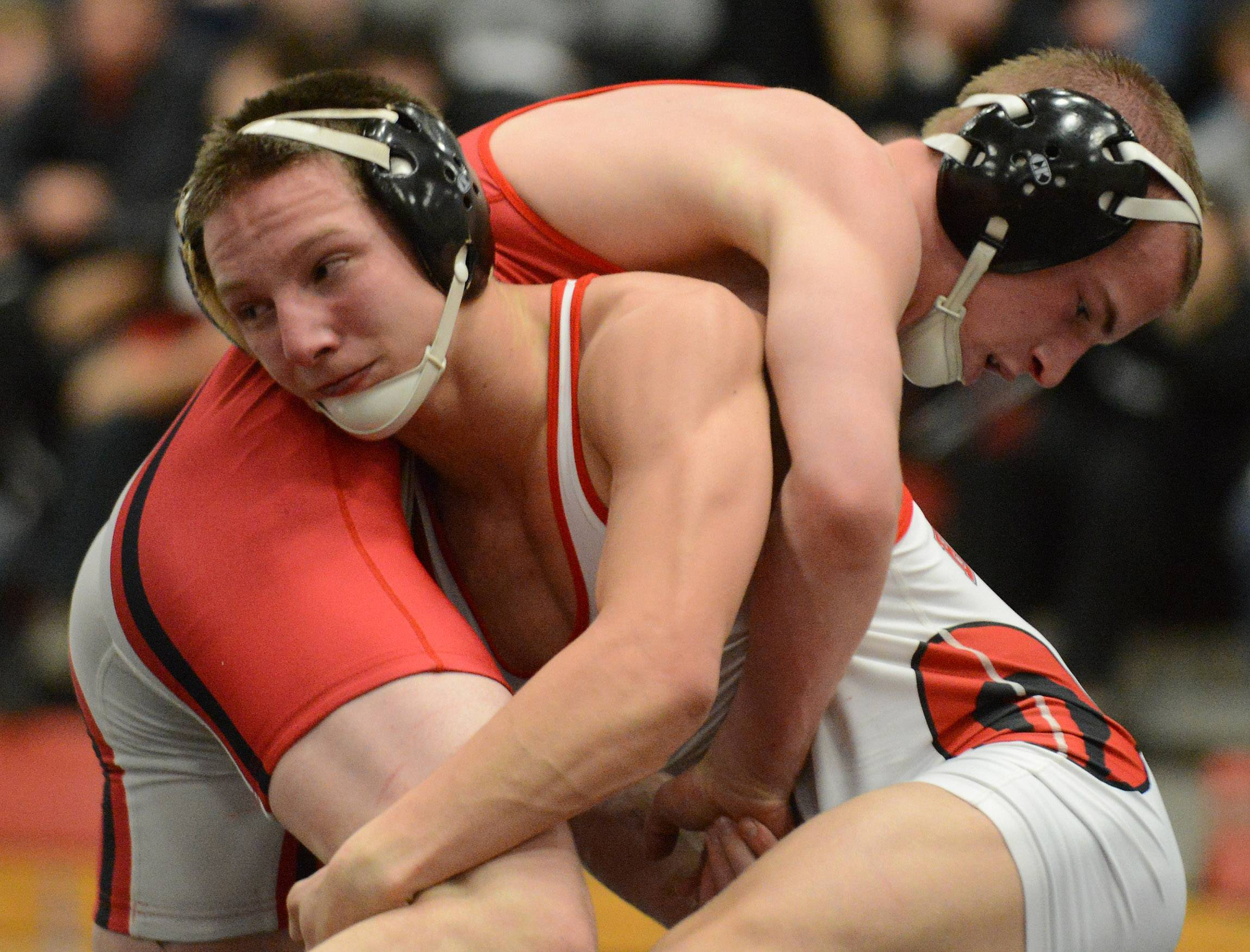 Barrington's Matt Conrad, in red, takes on Troy Parent of Grant in the 132-pound final in Barrington on Saturday.