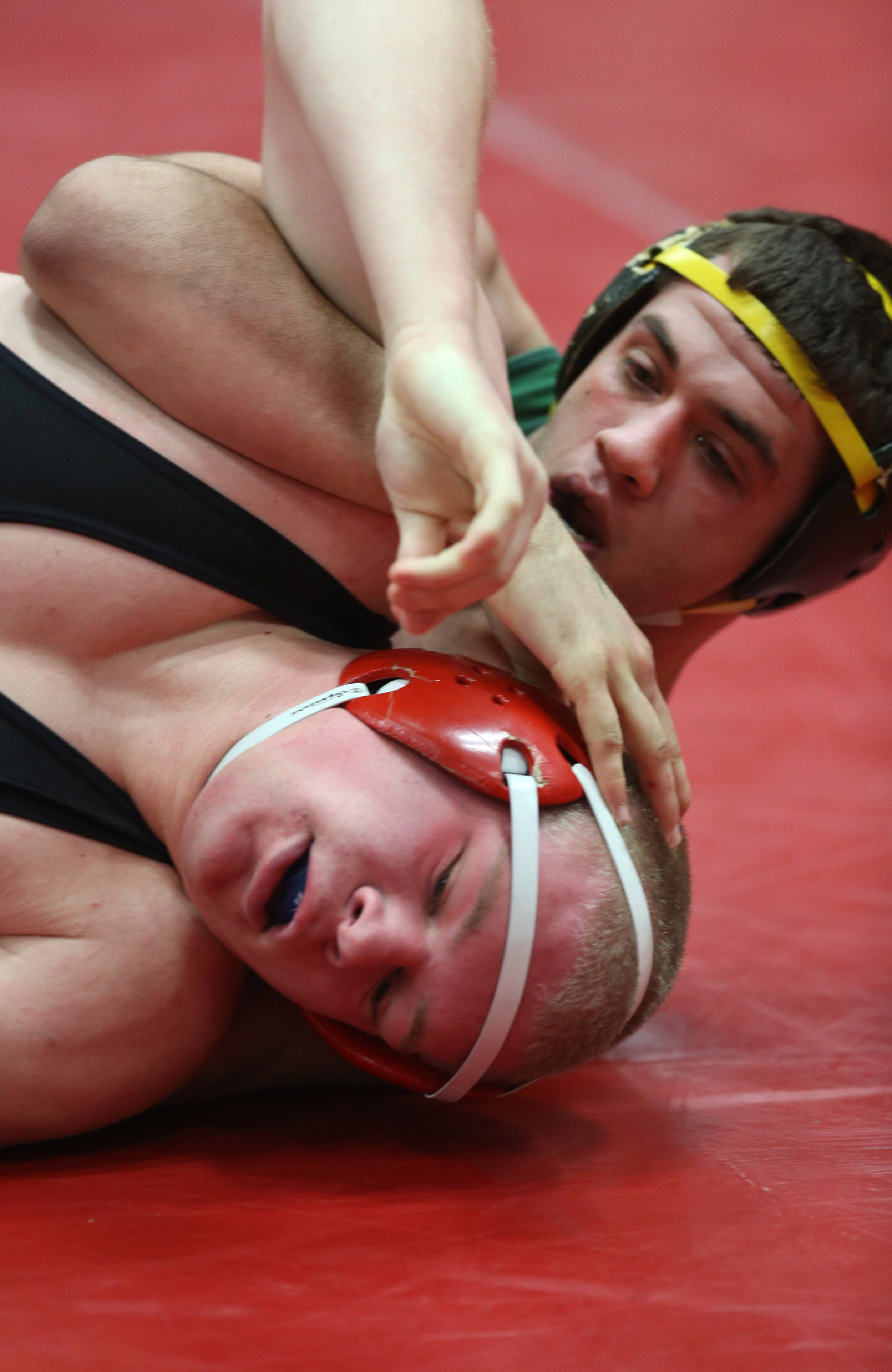 Batavia's Connor McKeehan, bottom, defeated Waubonsie Valley's Anthony Napolitano, top, during the Class 3A Hinsdale Central individual wrestling sectional semifinal.