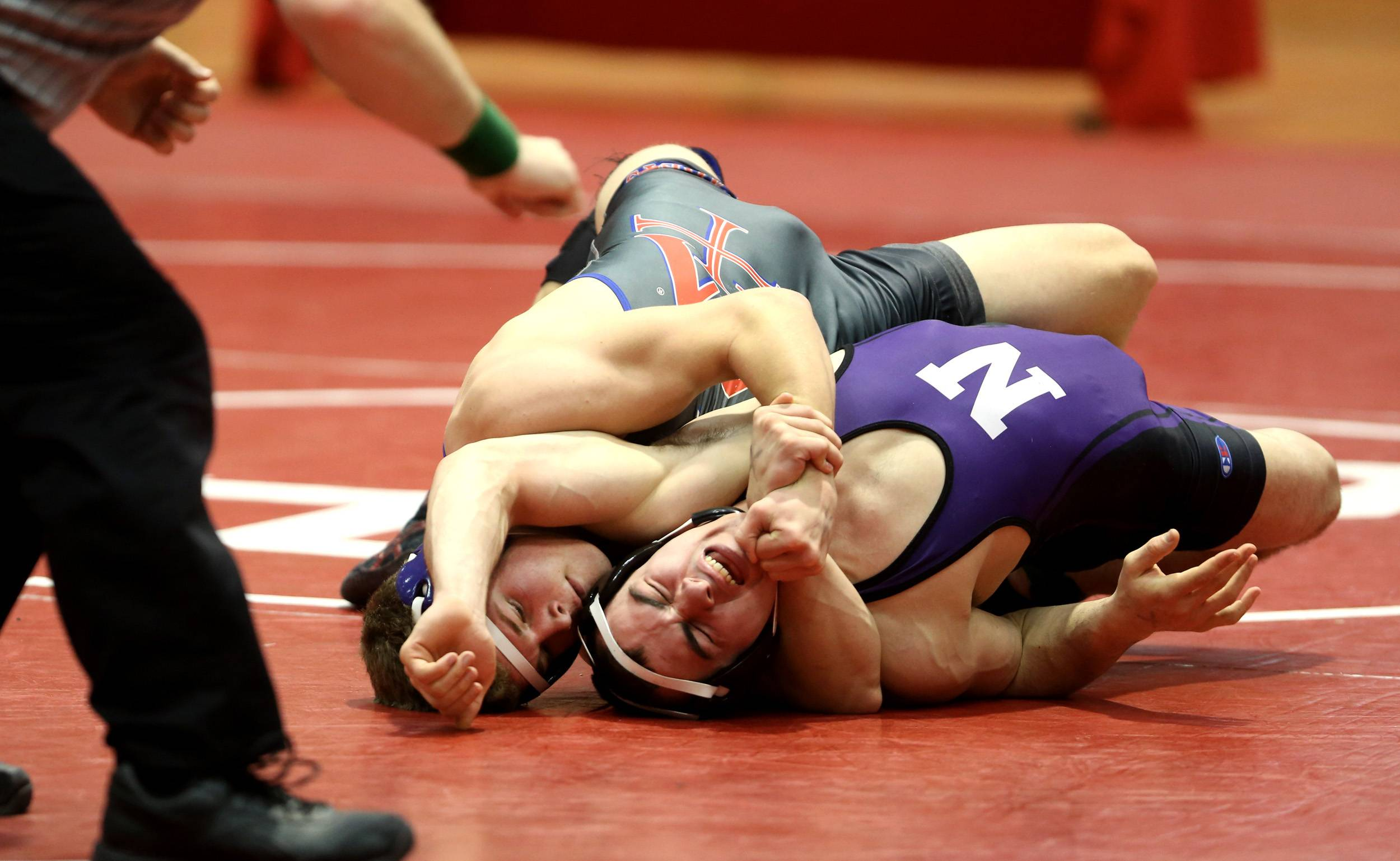 Marmion's Sam Breen, defeats Downers Grove North's Mike Gastedello in the 160 class during the third place semifinals of the 3A Hinsdale Central individual wrestling sectional.