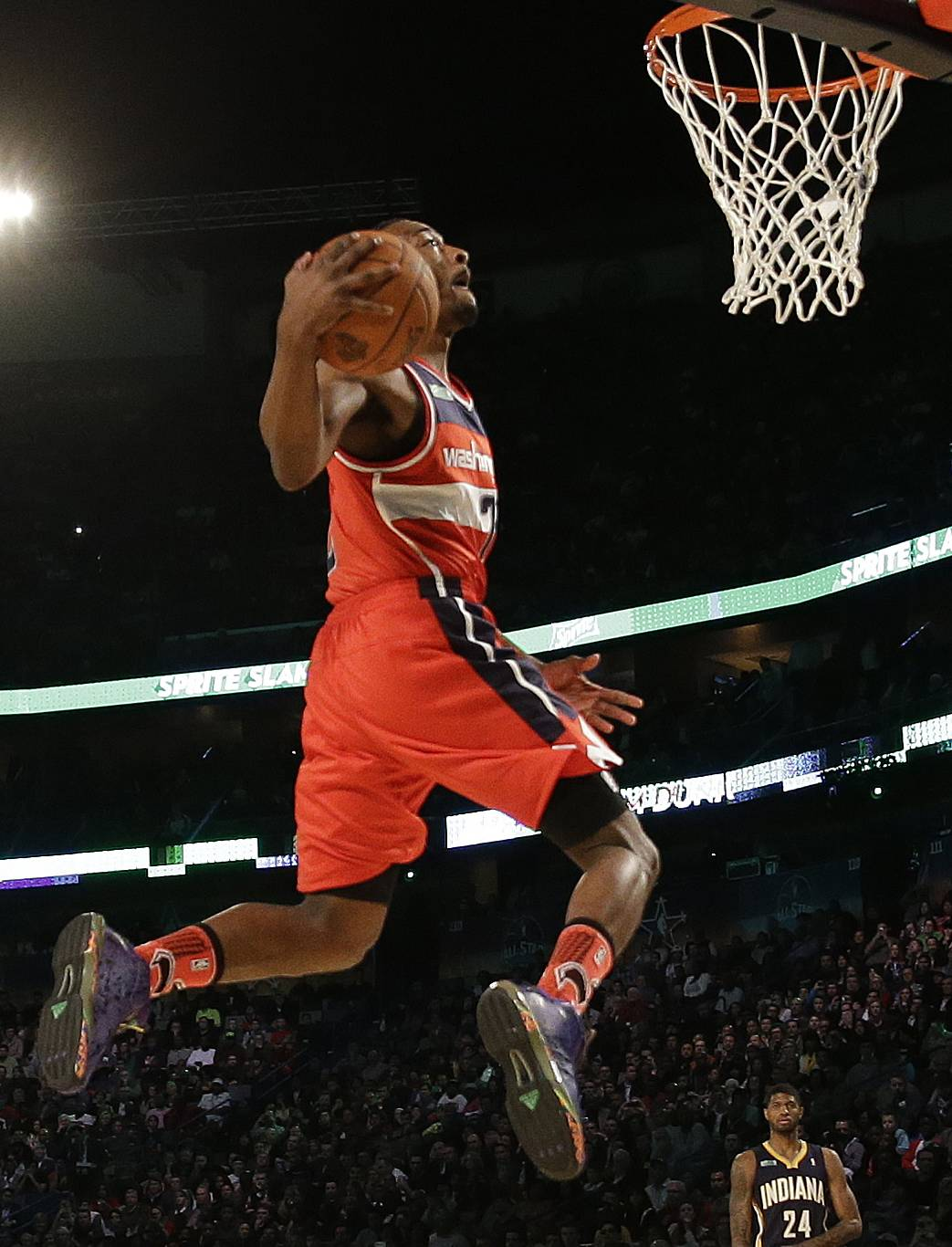 John Wall of the Washington Capitals participates in the slam dunk contest during the skills competition at the NBA All Star basketball game Saturday in New Orleans.