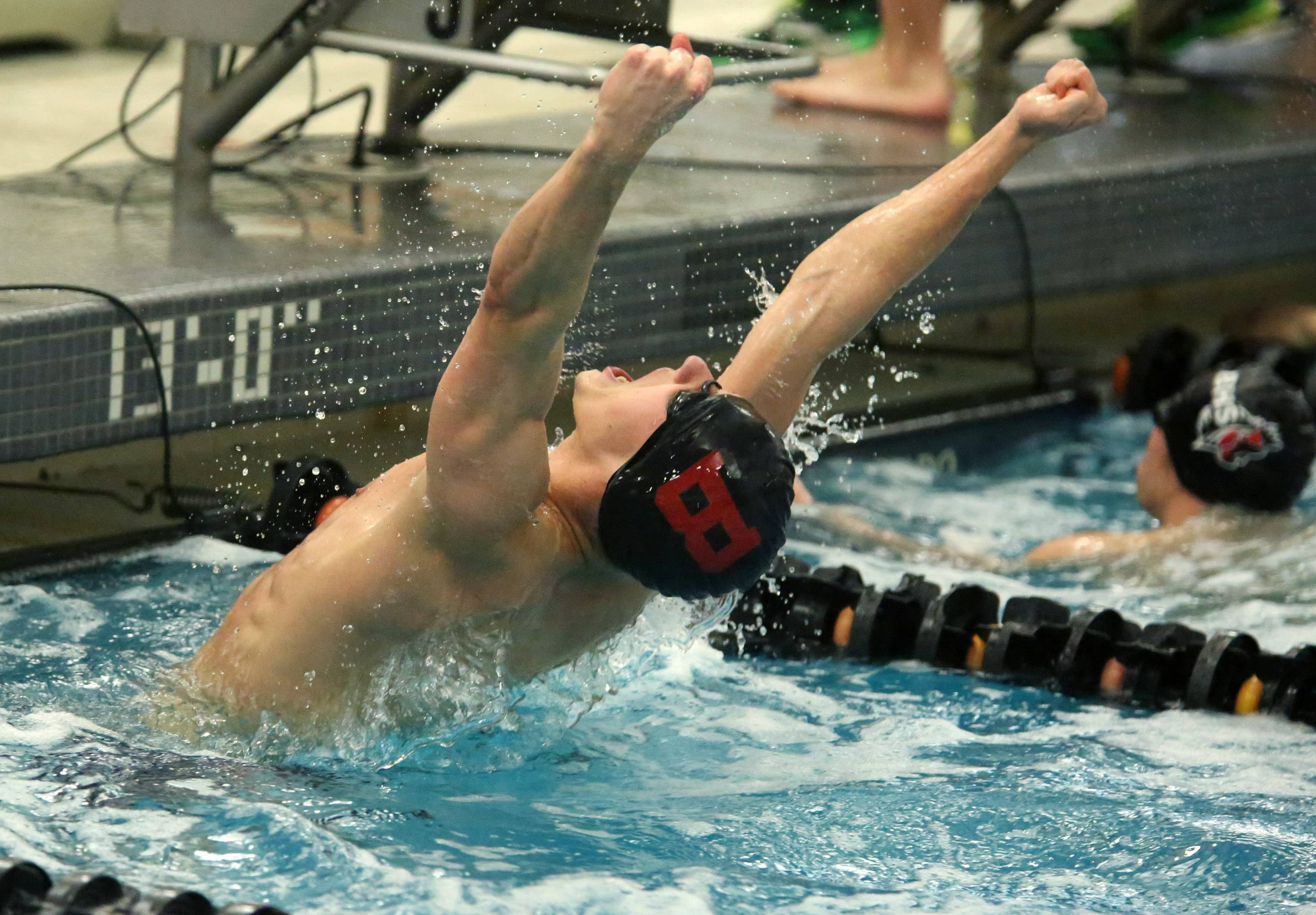 Barrington's Sebastian Piekarski reacts after winning the 50-yard freestyle at the Mid-Suburban League boys swimming meet Saturday at Barrington.
