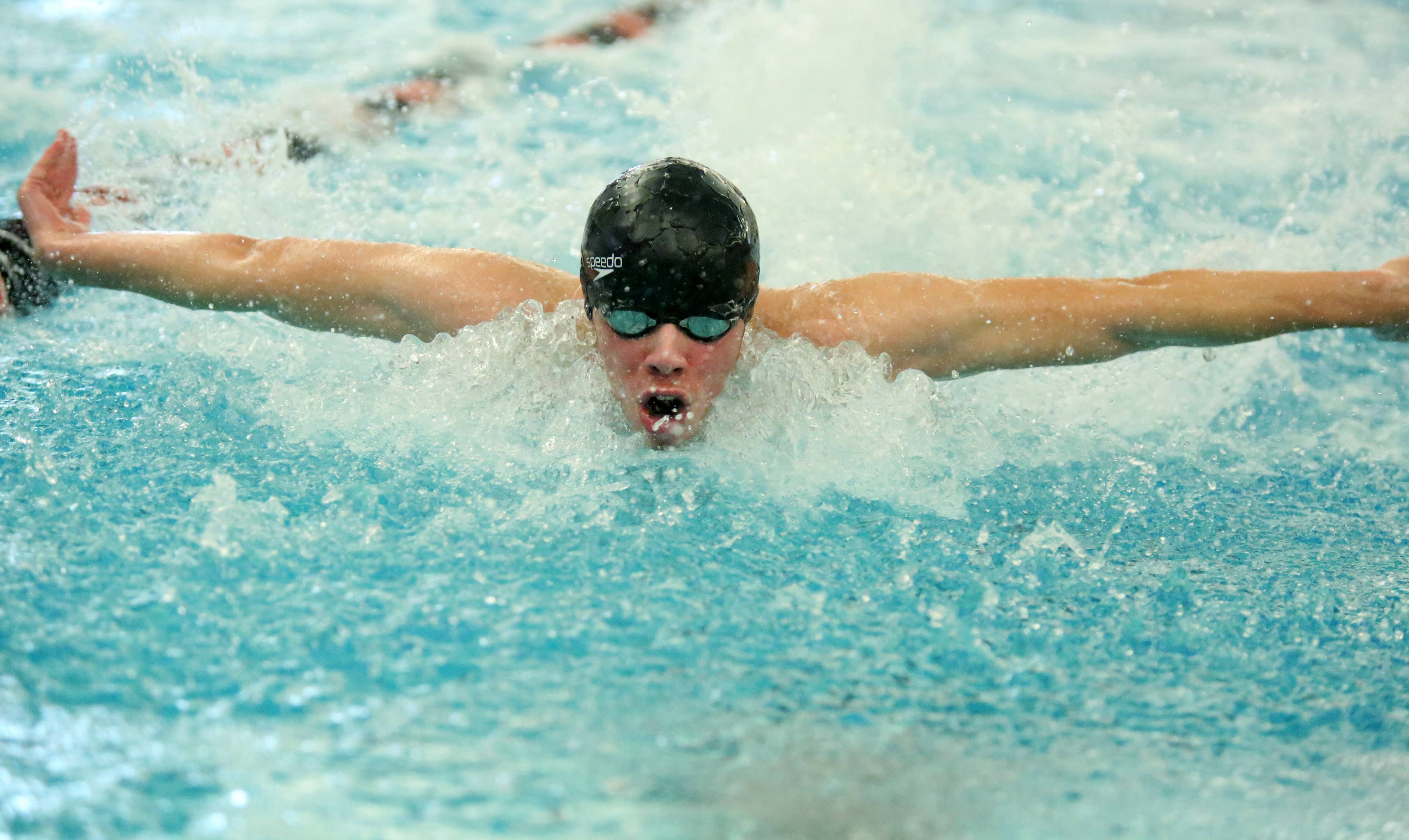 Elk Grove's Colin Williams heads for victory in the 100-yard butterfly in Saturday's Mid-Suburban League meet at Barrington.
