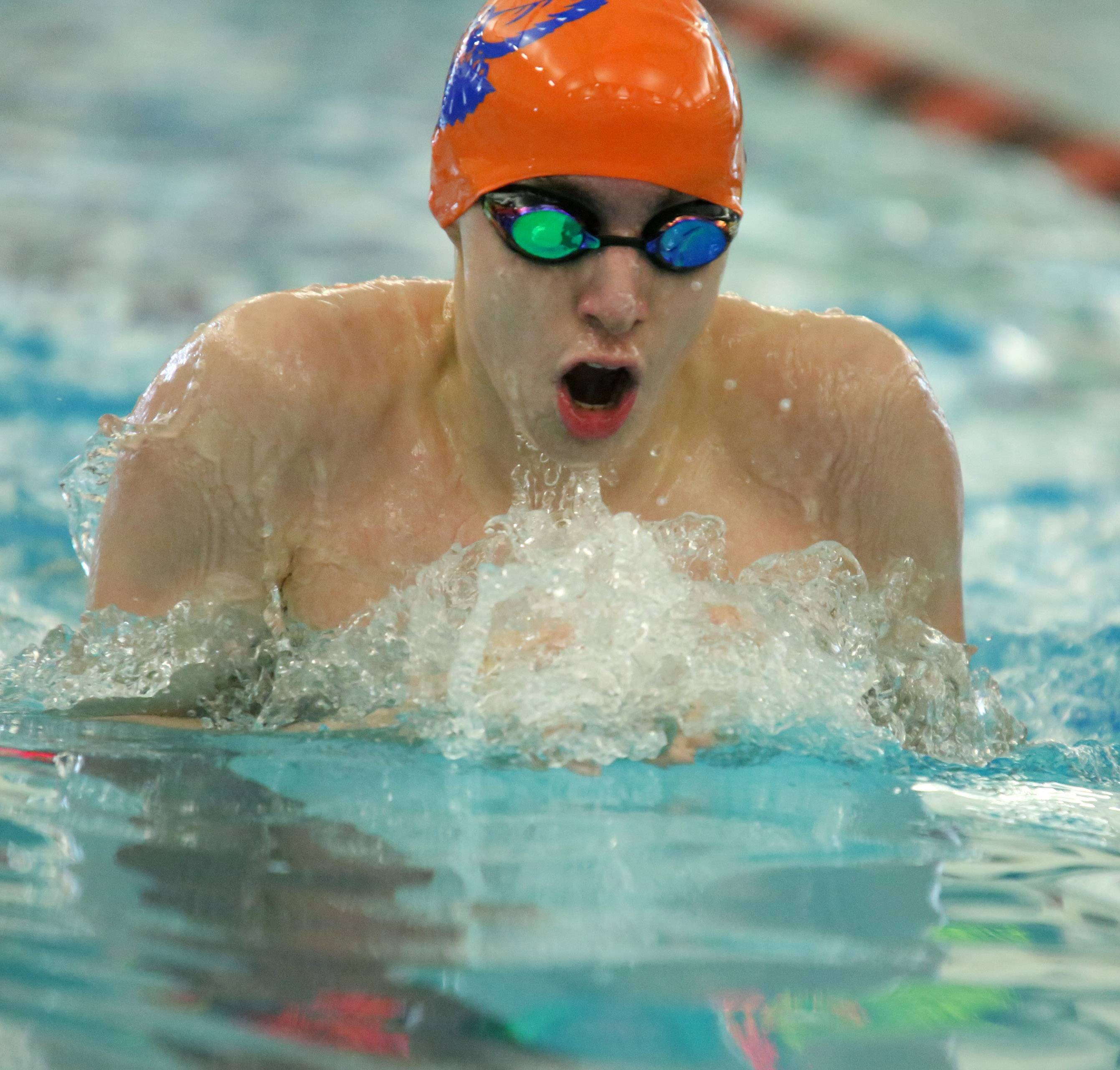 Hoffman Estates' Jacob Pasaye swims the 200-yard individual medley in the Mid-Suburban League meet Saturday at Barrington.