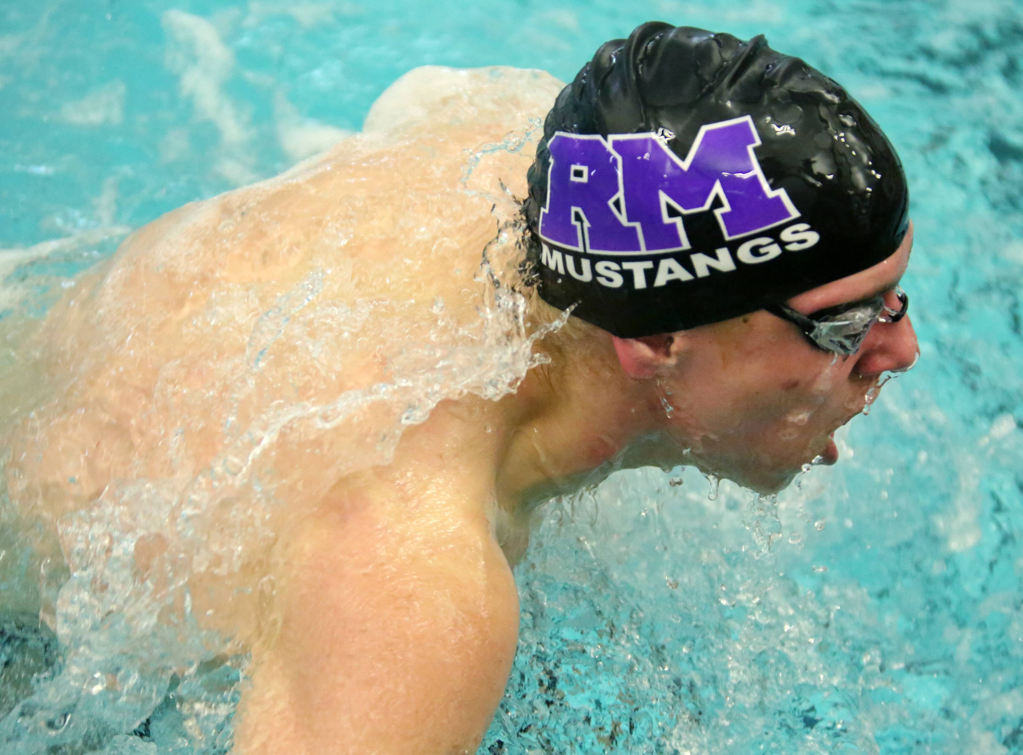 Rolling Meadow's Tony Sarussi makes the turn in the 100-yard butterfly in the Mid-Suburban League meet Saturday at Barrington.