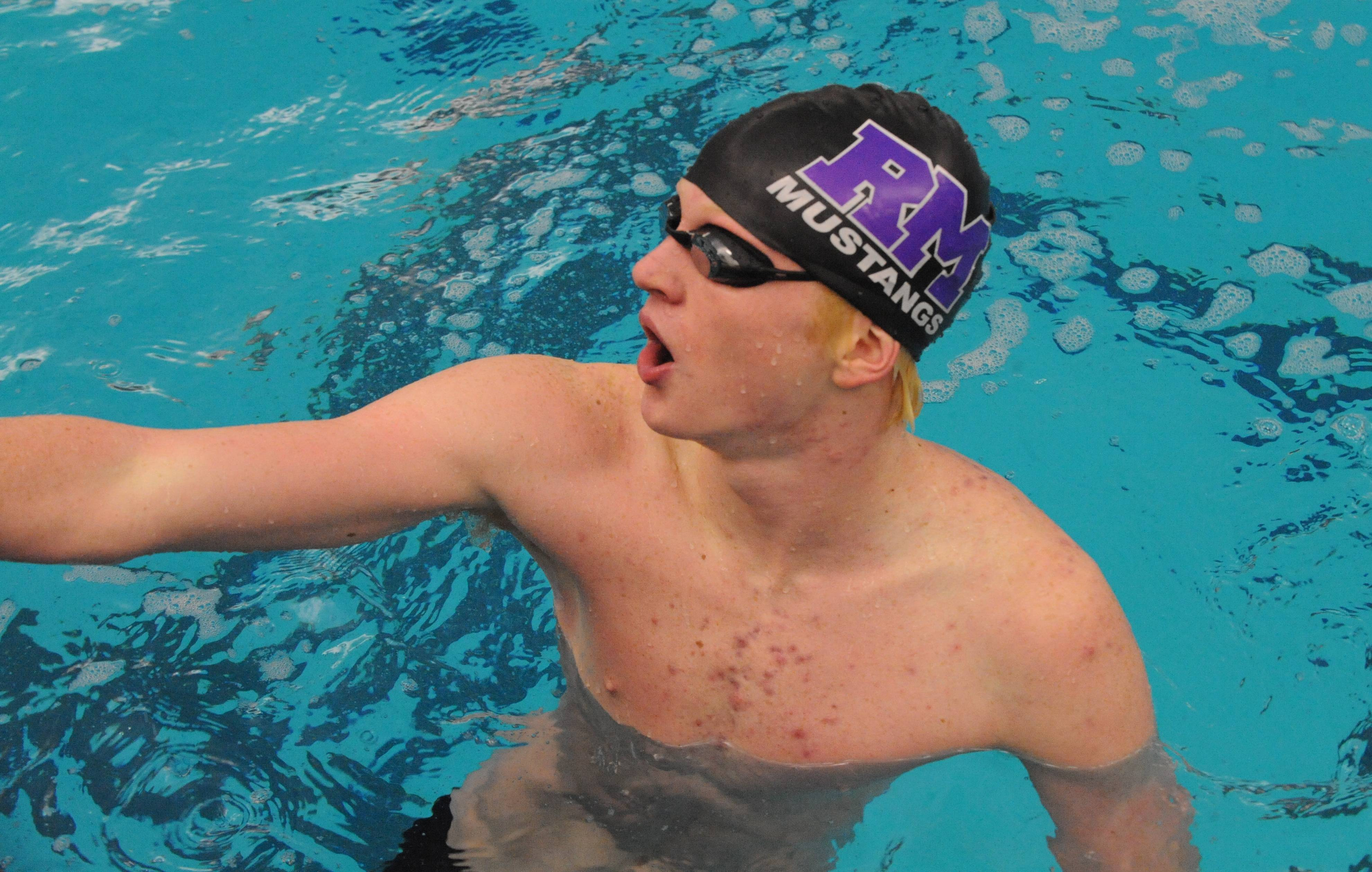 Rolling Meadows junior Jake Barson likes what he sees on the clock at Barrington after winning the 100-yard breaststroke in a team-record 59.35.