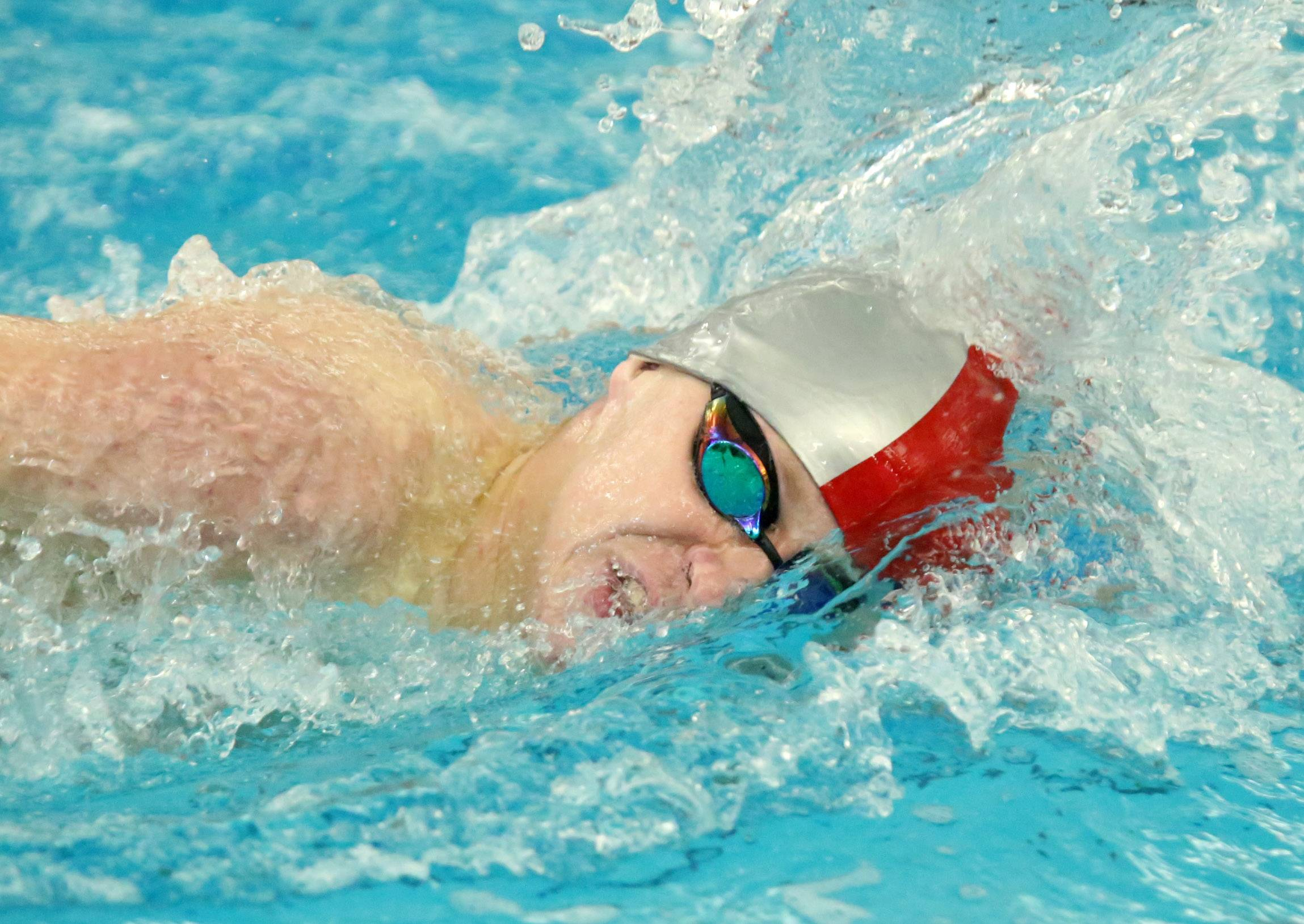 Wheeling's Kyle Noel wins the 200-yard freestyle in the Mid-Suburban League meet Saturday at Barrington.