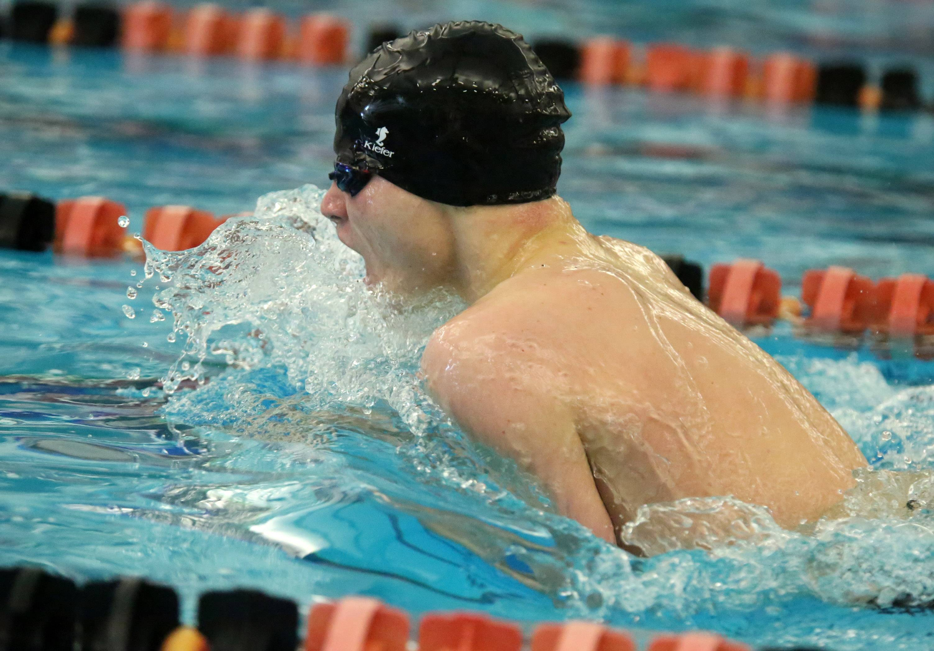 Wheeling's Jake Noel places first in the 200-yard individual medley in the Mid-Suburban League meet Saturday at Barrington.