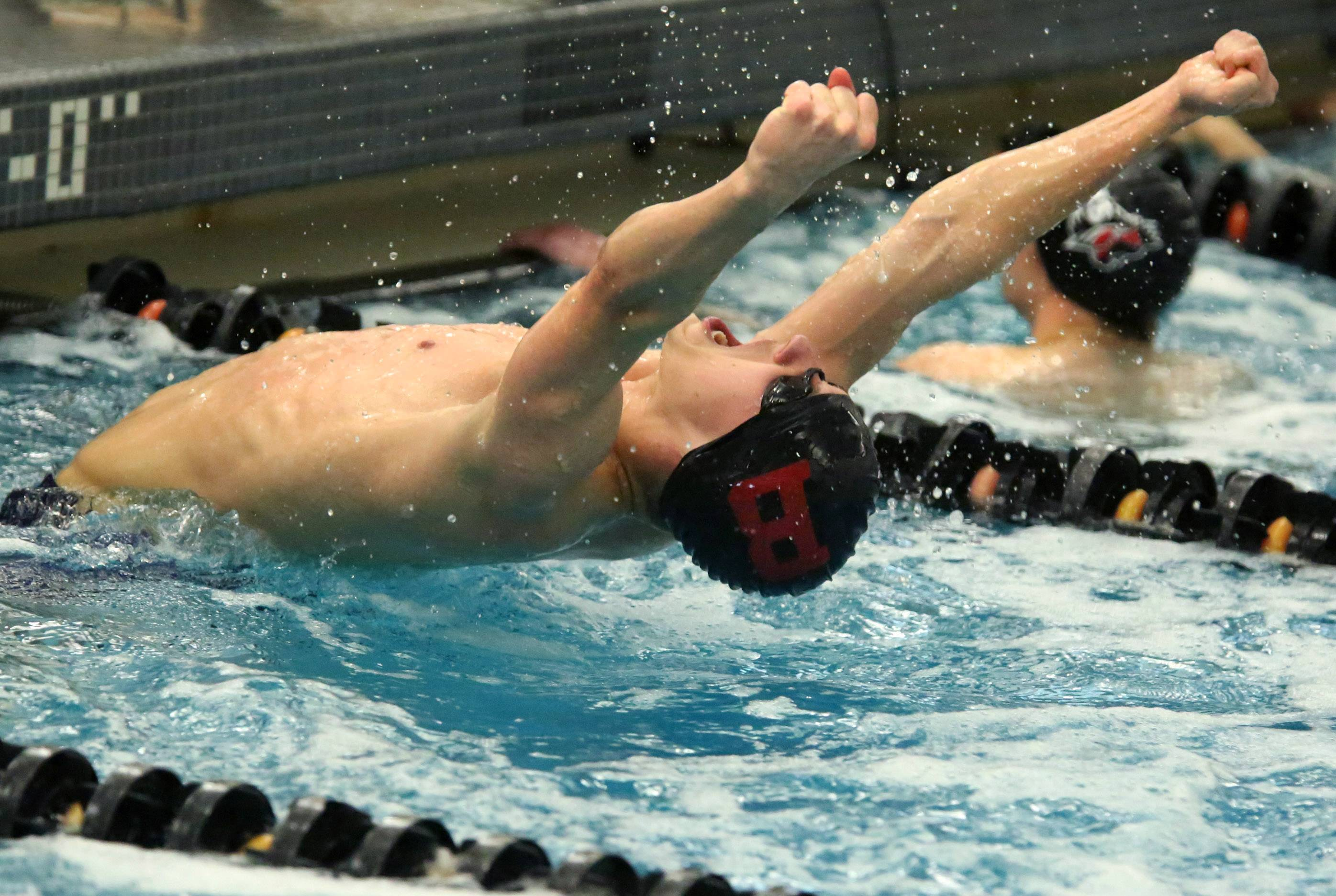 Barrington's Sebastian Piekarski reacts after winning the 50-yard freestyle in the Mid-Suburban League meet Saturday at Barrington.