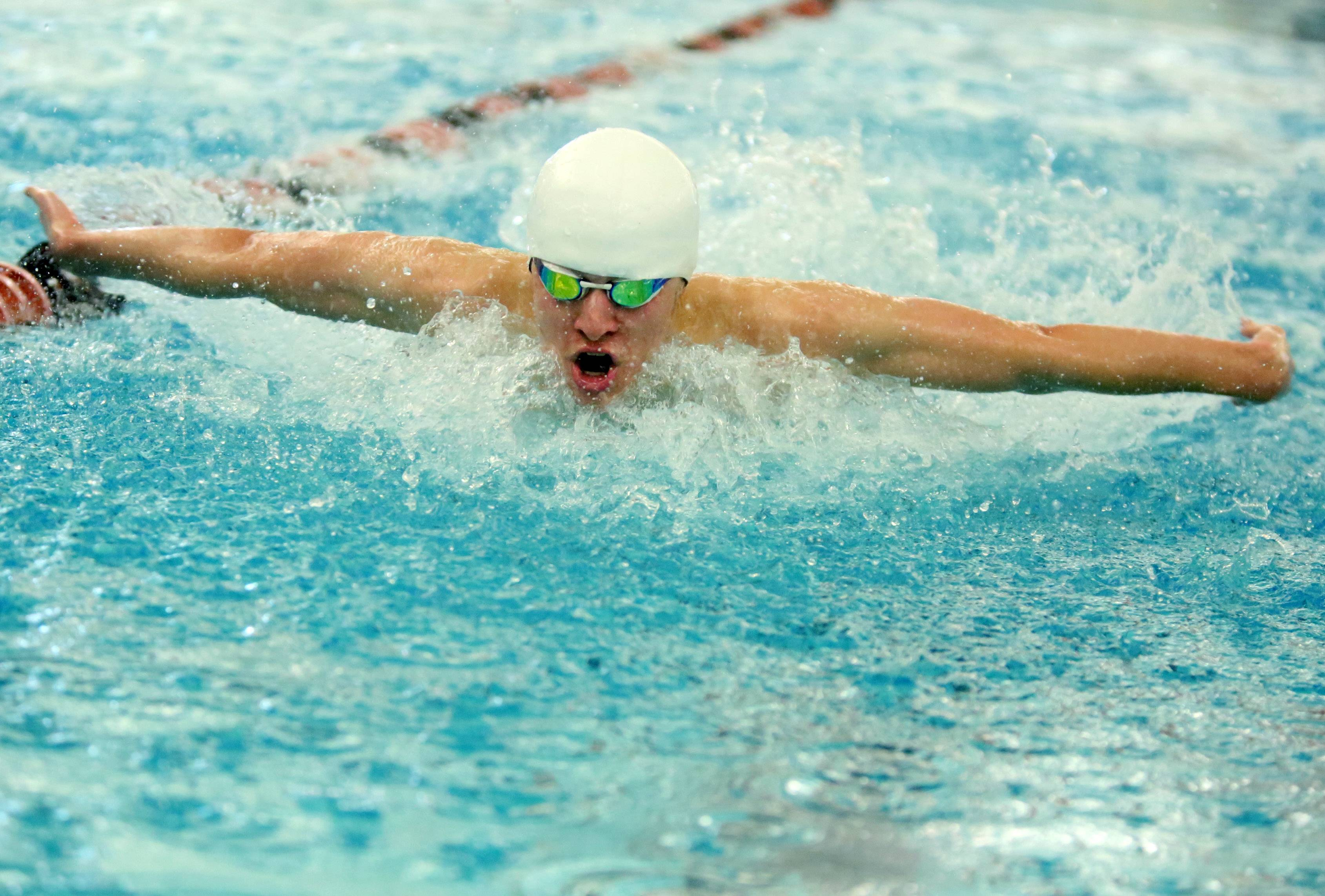 Palatine's Jordon Kalina swims the 100-yard butterfly in the Mid-Suburban League meet Saturday at Barrington.