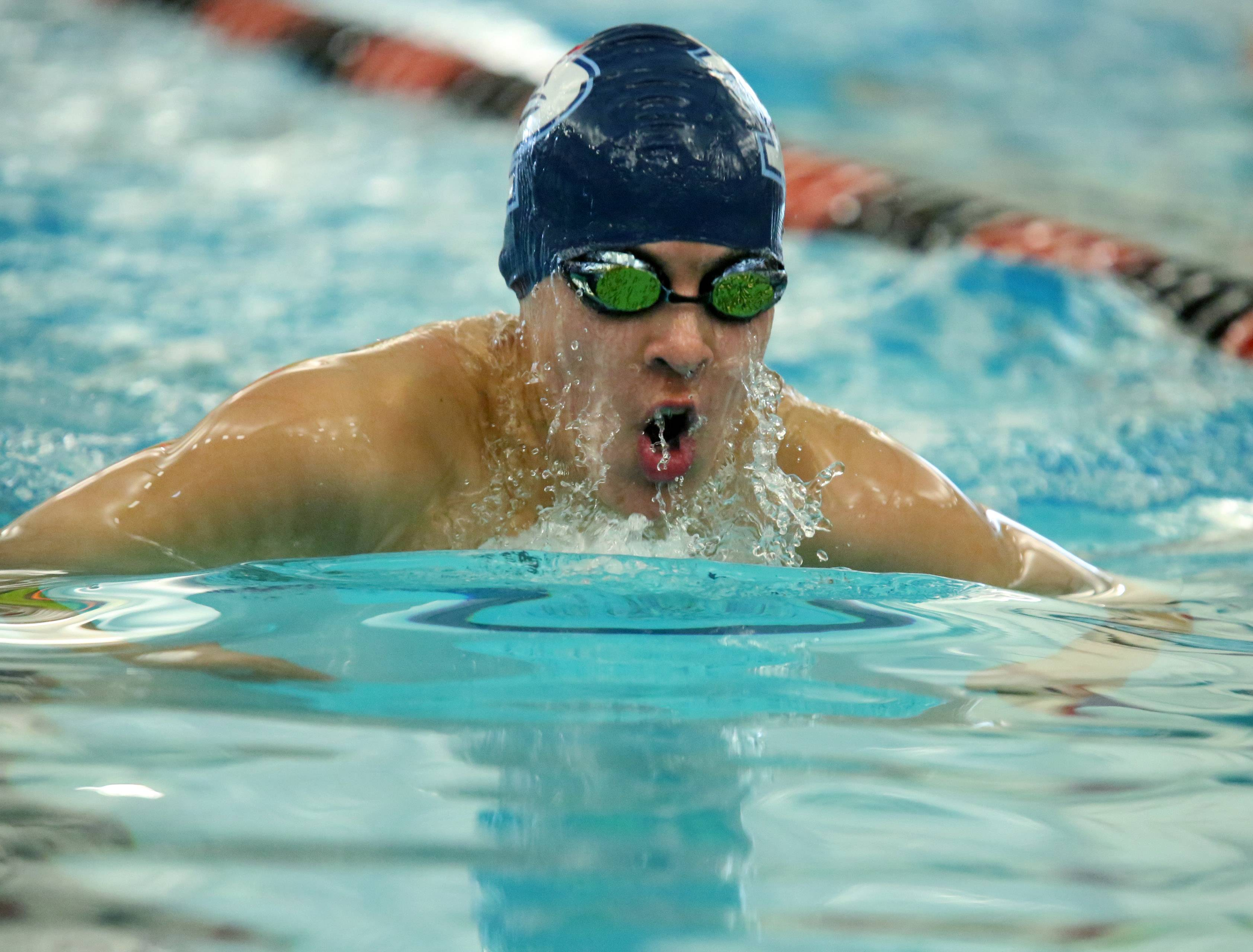 Palatine's Arnas Maciunas swims the 200-yard IM in the Mid-Suburban League meet Saturday at Barrington.