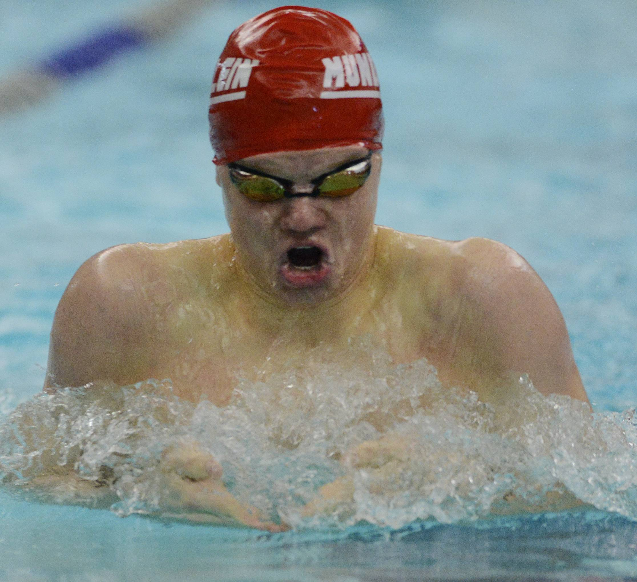 Mundelein's Ayrton Kasemets swims breaststroke in the 200-yard individual medley during the North Suburban Conference boys swimming meet at Vernon Hills on Saturday.