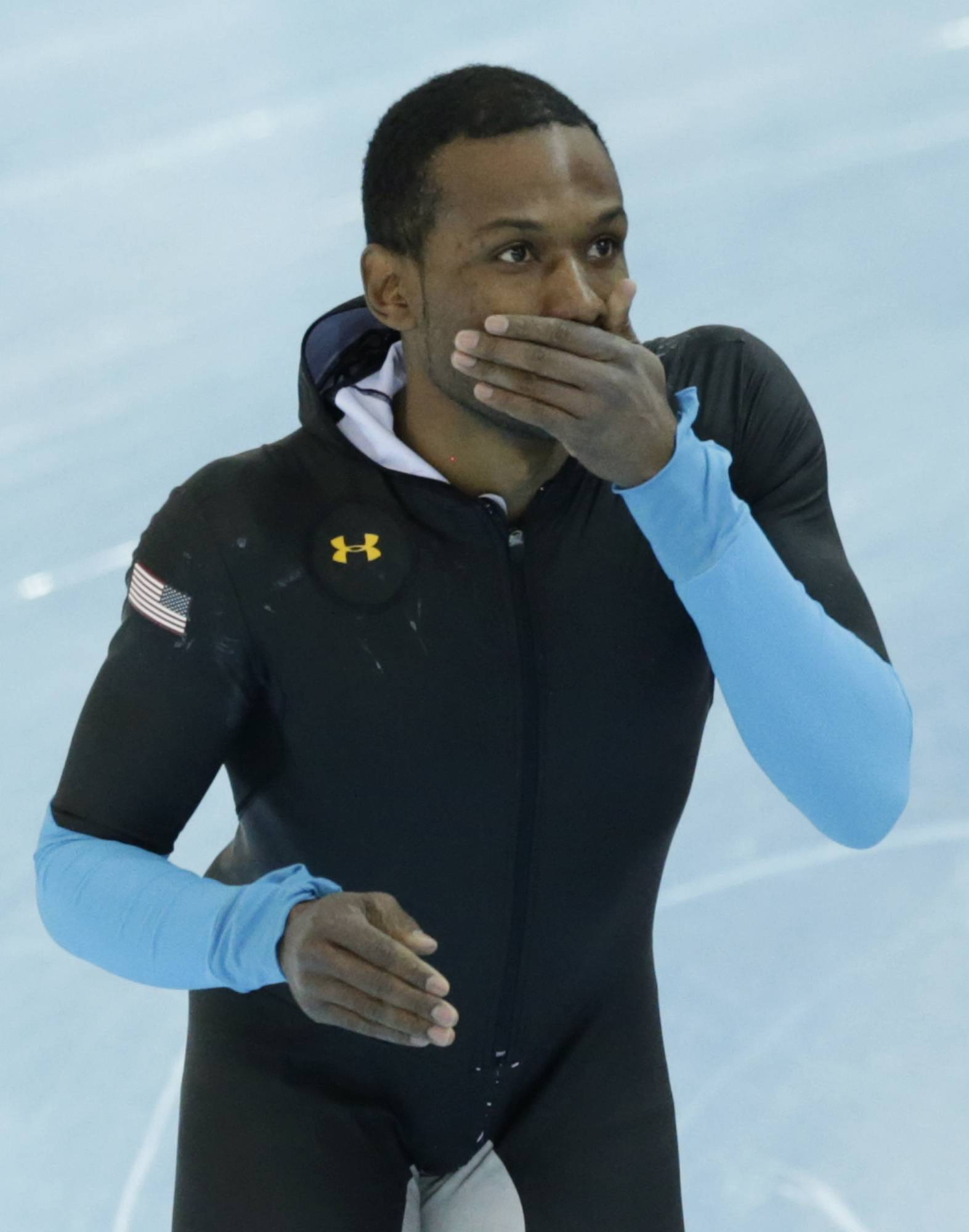 Shani Davis of the U.S. covers his mouth after  competing in the men's 1,500-meter speedskating race at the Adler Arena Skating Center during the 2014 Winter Olympics in Sochi, Russia, Saturday, Feb. 15, 2014.