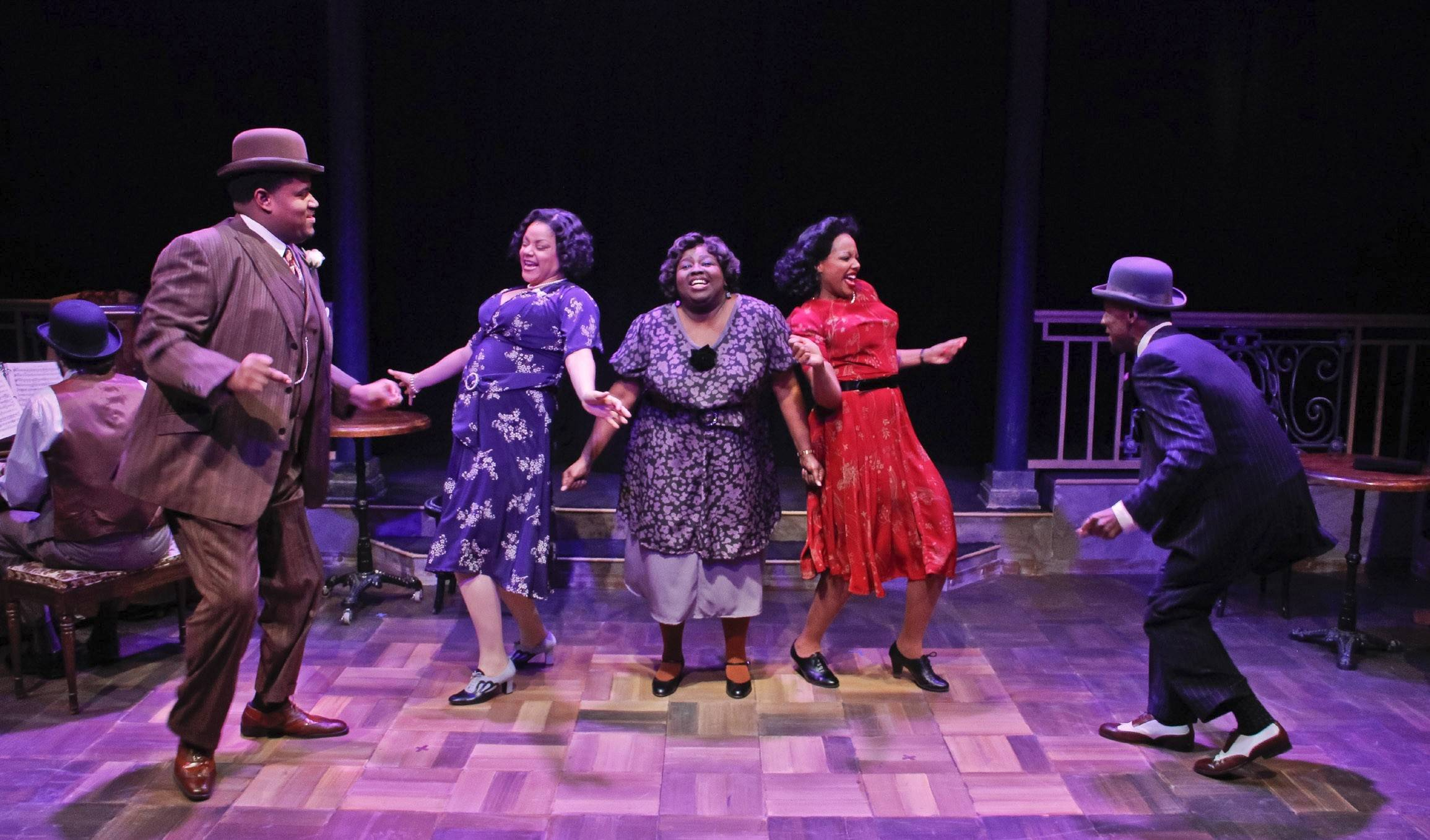 "Lorenzo Rush Jr., left, Lina Wass, Robin DaSilva, Sharriese Hamilton and Donterrio Johnson heat up the stage in Porchlight Music Theatre's rollicking revival of the Fats Waller revue, ""Ain't Misbehavin'."""