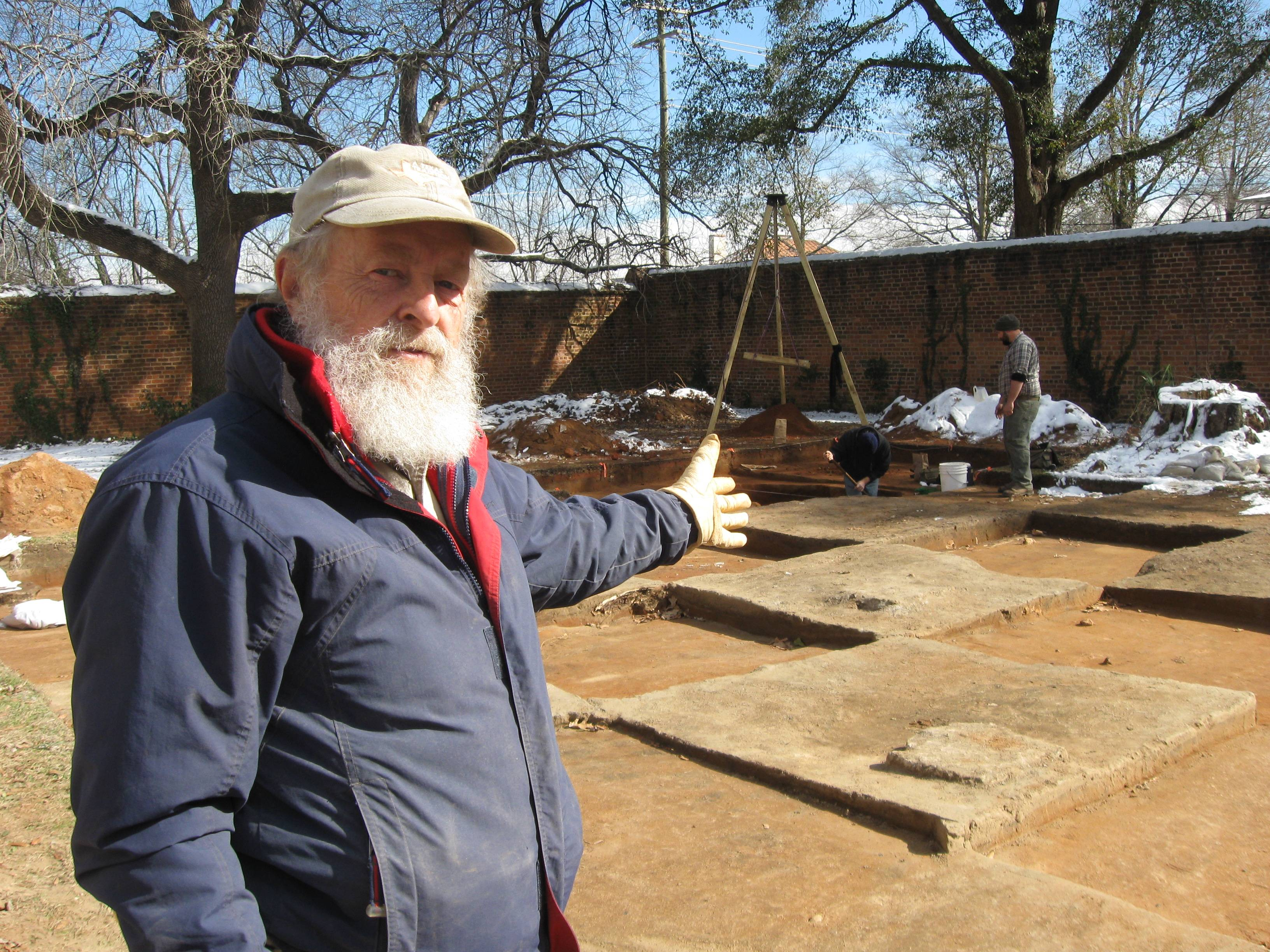 "In this Jan. 30, University of South Carolina research archaeologist Chester DePratter stands by the archaeological dig of ""Camp Asylum,"" the Civil War-era prison that once held 1,500 Union officers on the grounds of the state mental hospital in Columbia, S.C., in the waning days of the Civil War. Racing against time, South Carolina archeologists are digging to uncover the remnants of a Civil War-era prisoner-of-war camp before the site in downtown Columbia is cleared to make room for a mixed-use development."