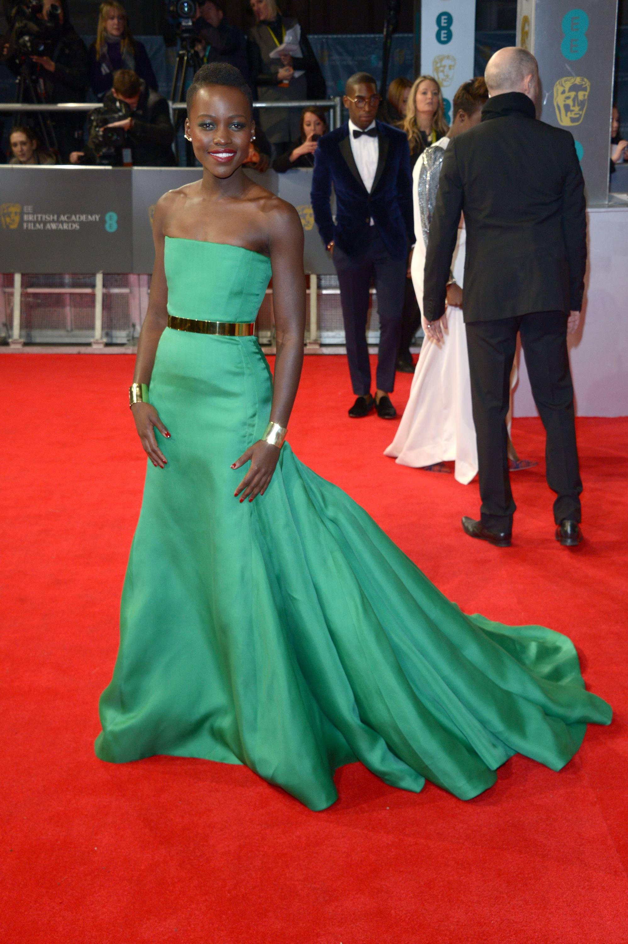 Kenyan actress Lupita Nyong'o poses for photographers on the red carpet at the EE British Academy Film Awards held at the Royal Opera House on Sunday Feb. 16, 2014, in London.