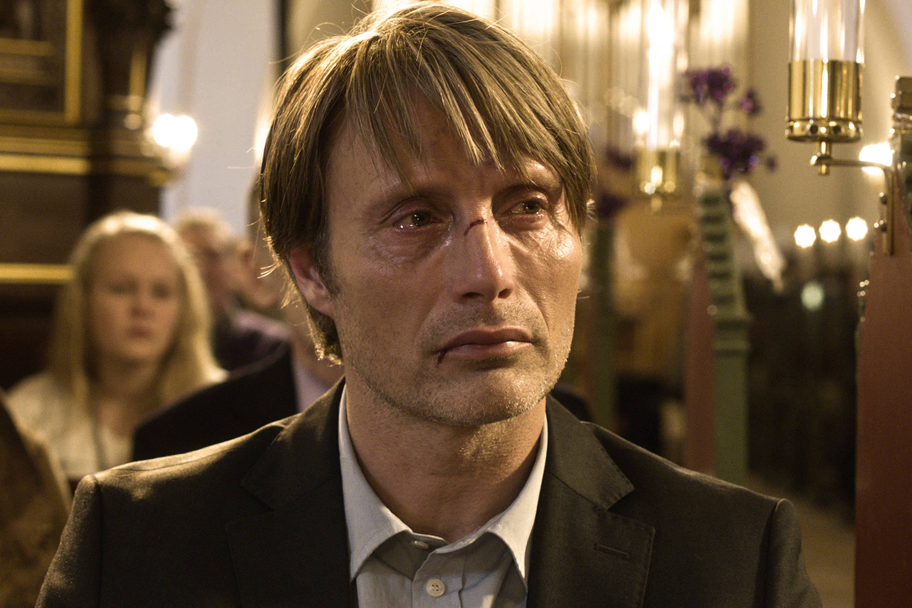 "Mads Mikkelsen plays a lonely teacher in his 40s whose life crumbles because of an innocent lie in ""The Hunt,"" nominated for Best Foreign Language Film."