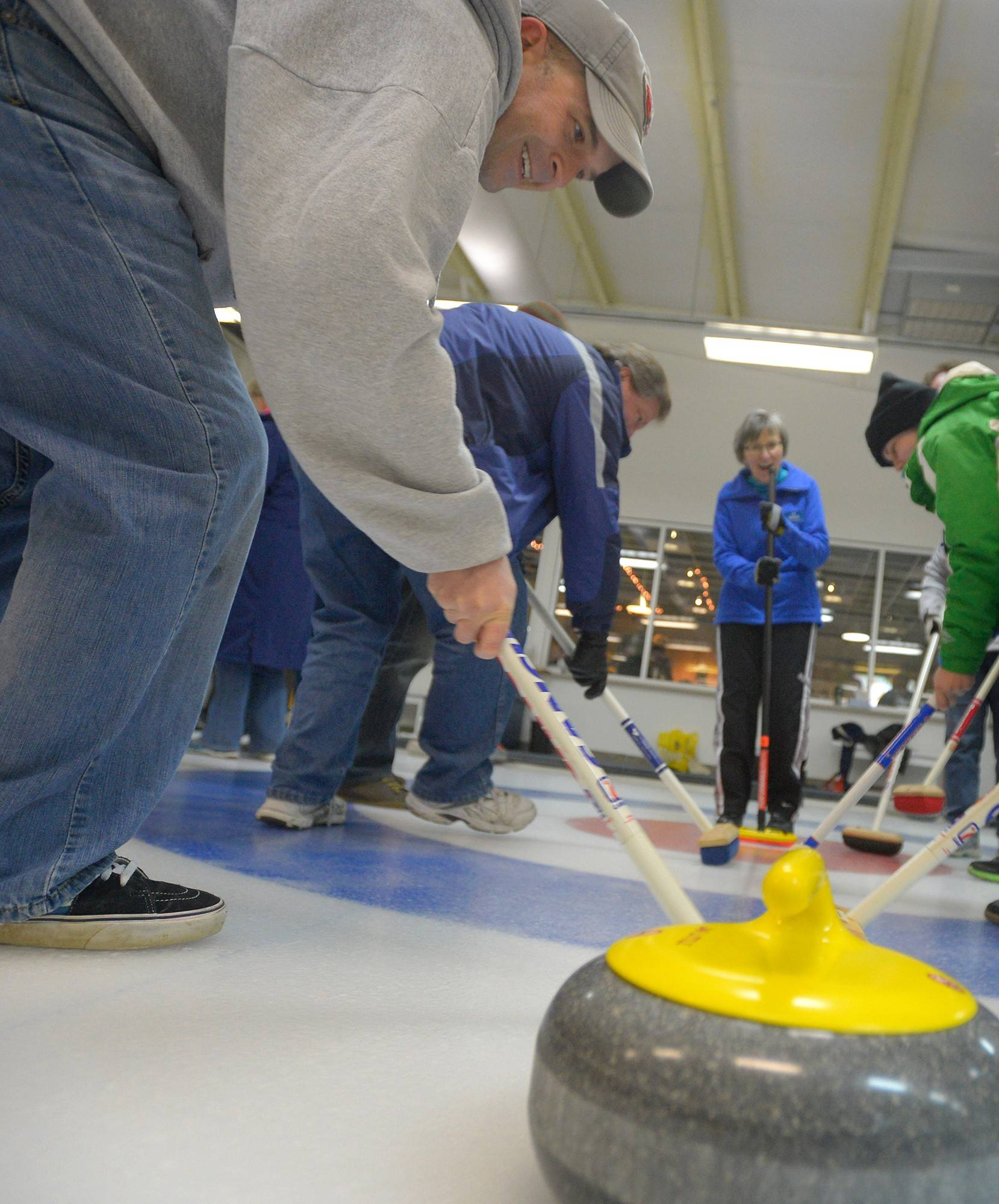 J.D. Oltman practices his sweeping skills with other novices ahead of a moving rock.